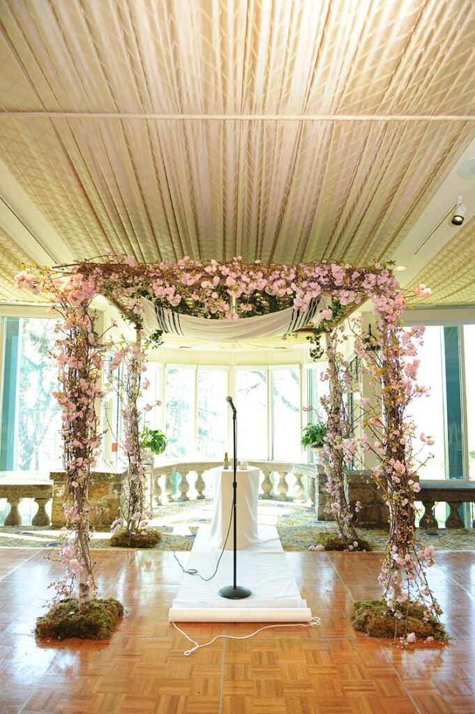 Cherry blossom decorated chuppah for a spring ceremony at Tappan Hill Mansion in Tarrytown.