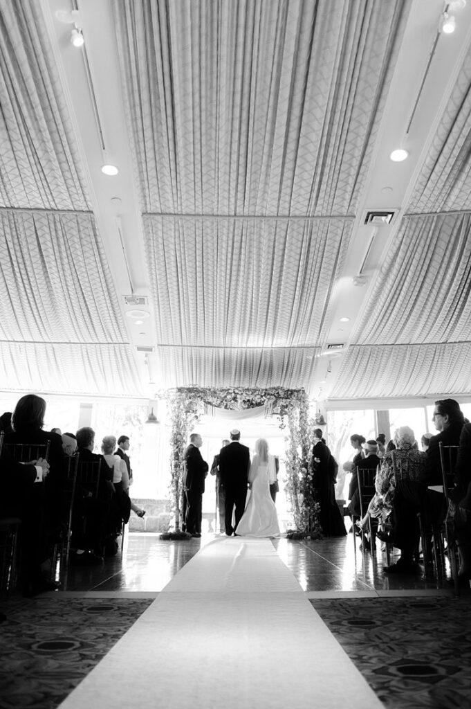 Bride and groom under a chuppah during their Jewish ceremony at Tappan Hill Mansion.
