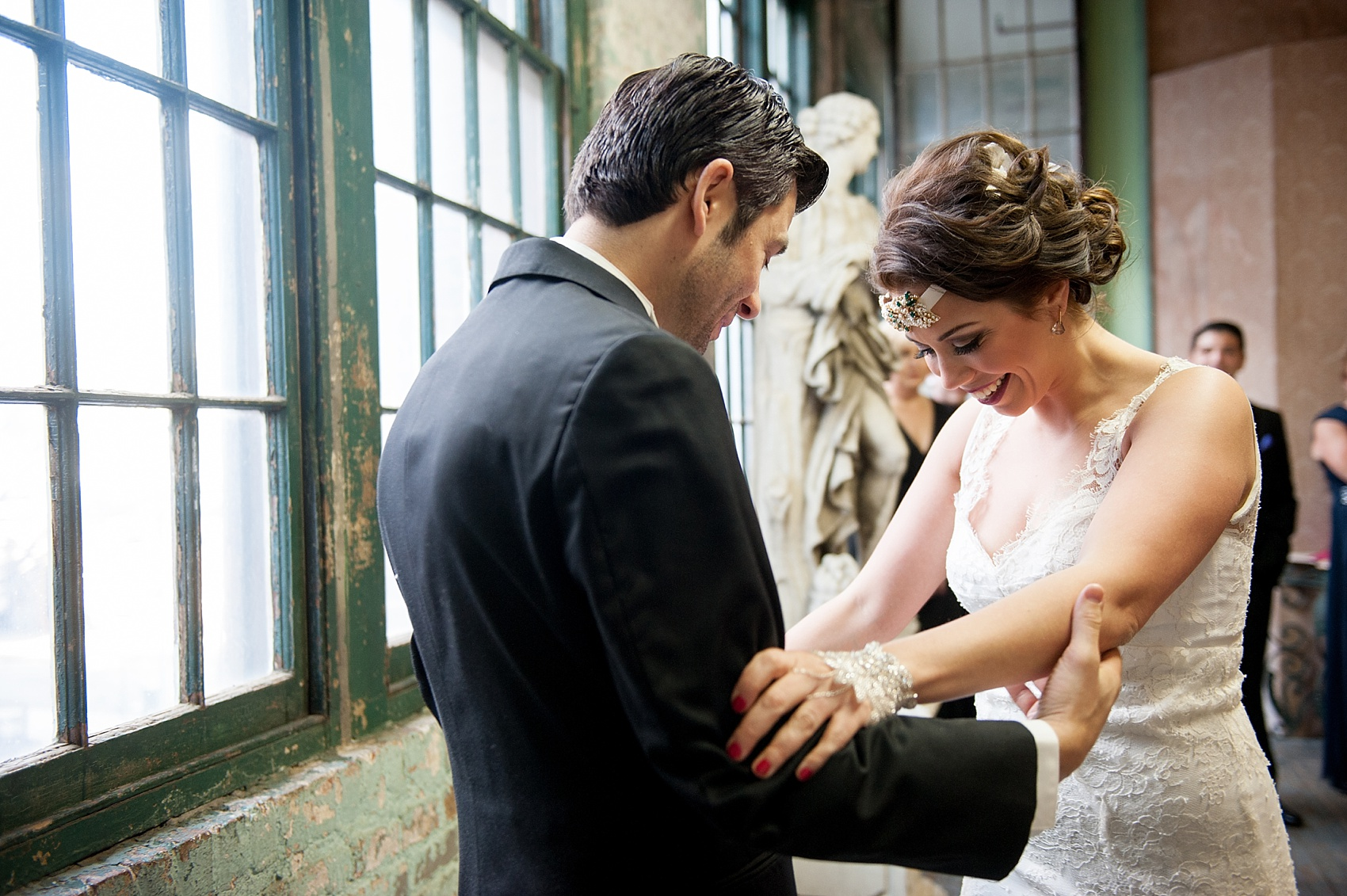 Metropolitan Building vintage 1920's wedding first look. Images by Mikkel Paige Photography.