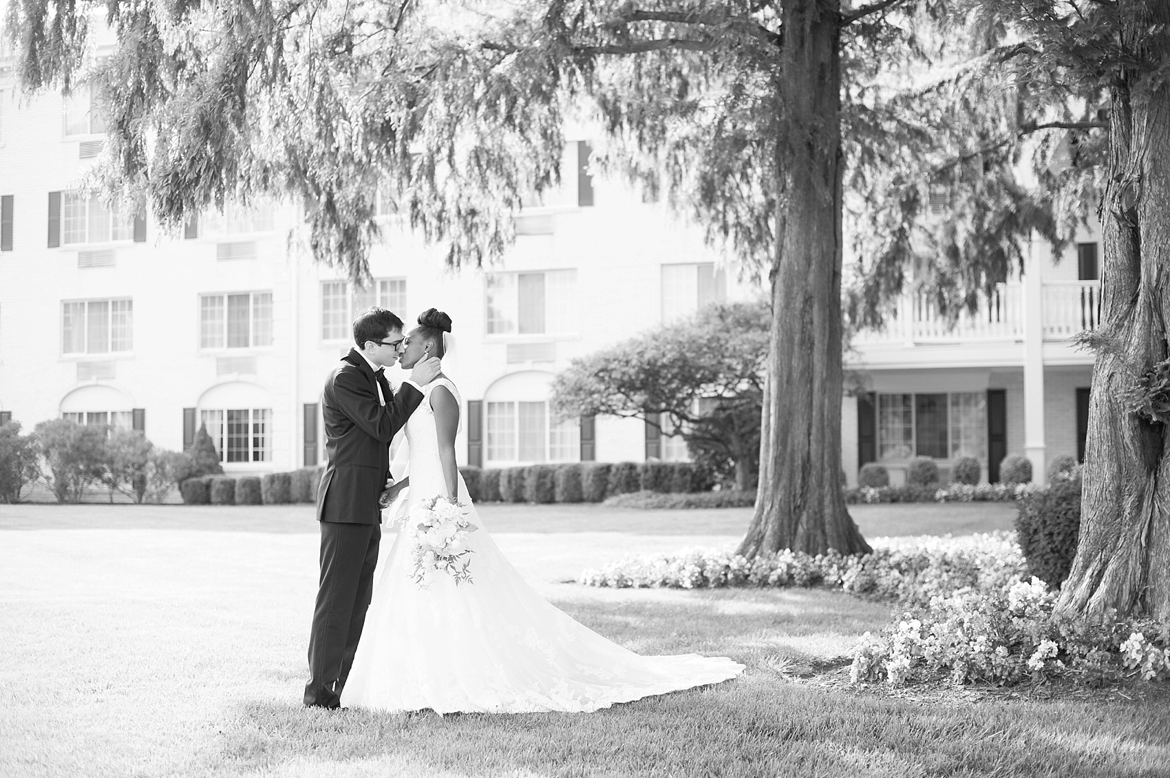 Bride and groom kiss at The Conservatory at the Madison Hotel, New Jersey. Photos by Mikkel Paige Photography.