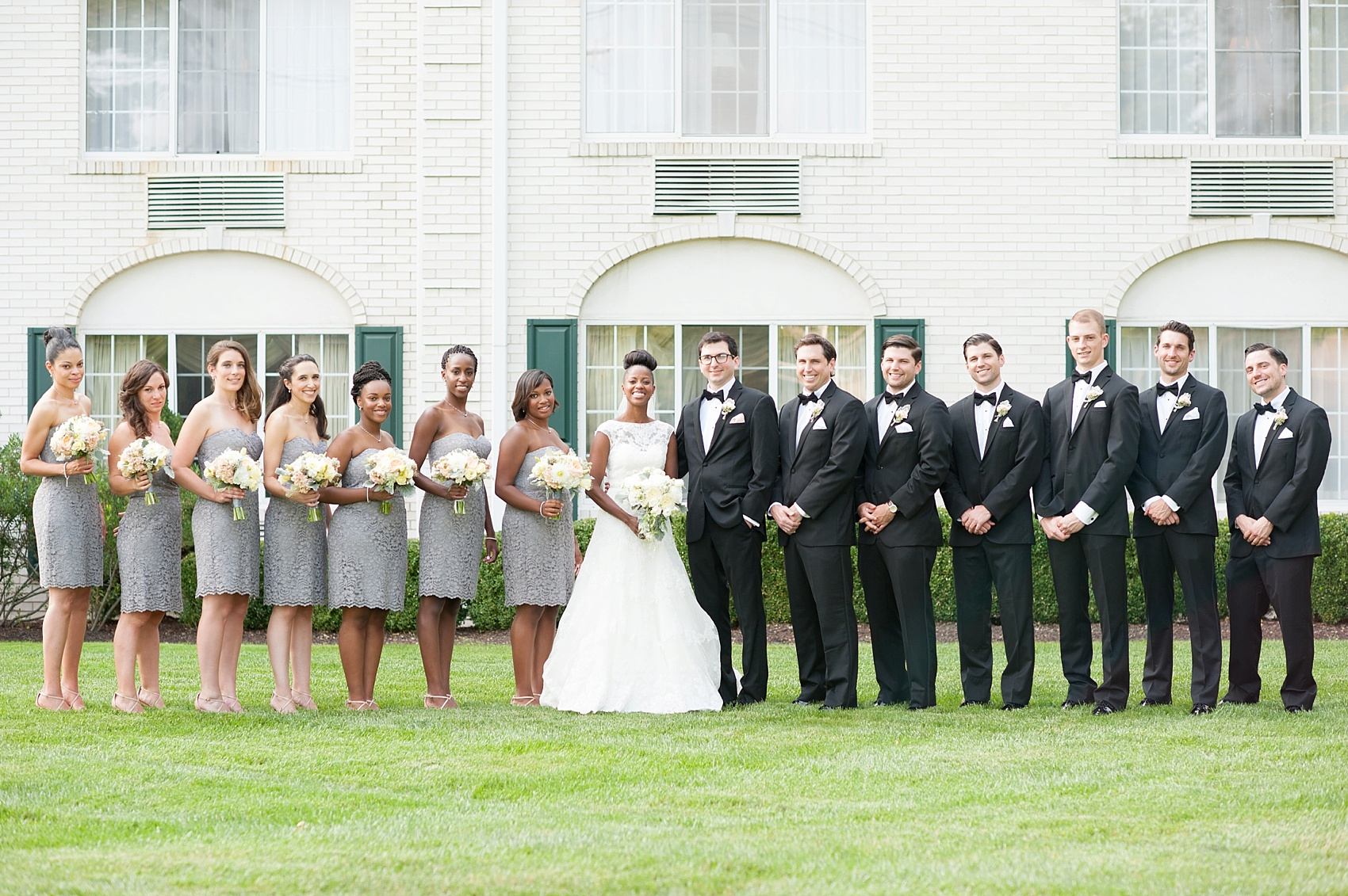 Wedding party in grey lace and black tuxedos at The Conservatory at the Madison Hotel, New Jersey. Photos by Mikkel Paige Photography.