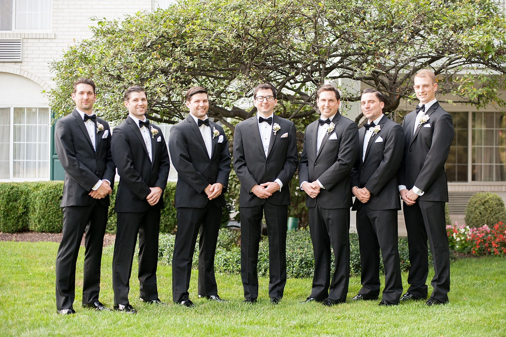 Groomsmen in Black by Vera Wang at The Conservatory at the Madison Hotel, New Jersey. Photos by Mikkel Paige Photography.