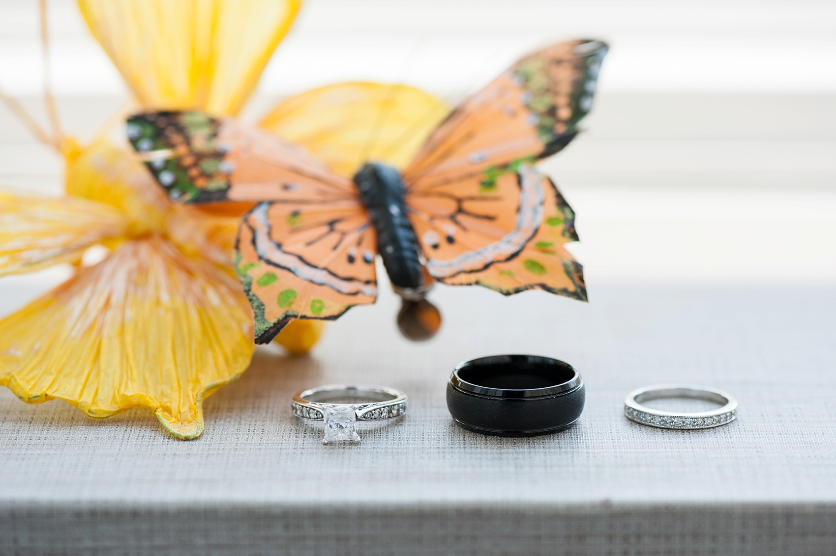 Butterflies to commemorate the bride's mother with their wedding bands. Hollow Brook Golf Club wedding with photos by Mikkel Paige Photography.