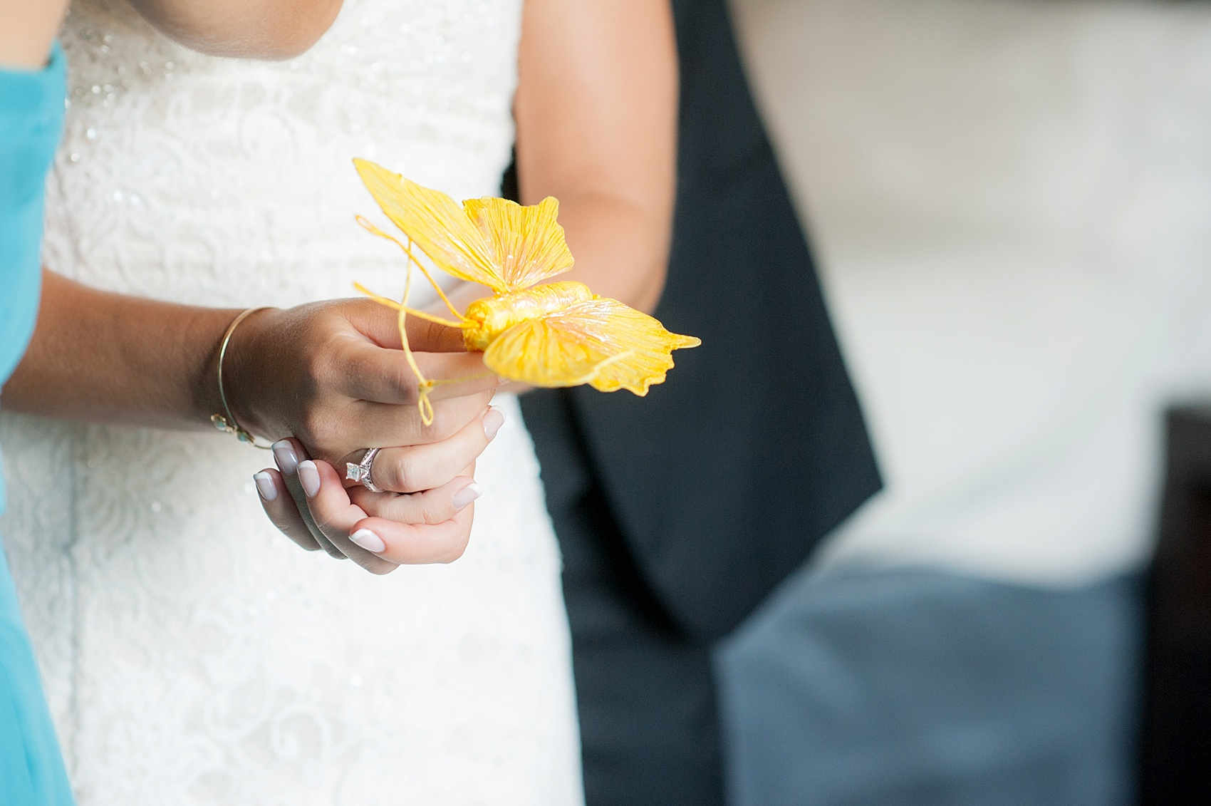Bride getting ready with a butterfly in her mother's memory for her Hollow Brook Golf Club wedding in New York. Photos by Mikkel Paige Photography.