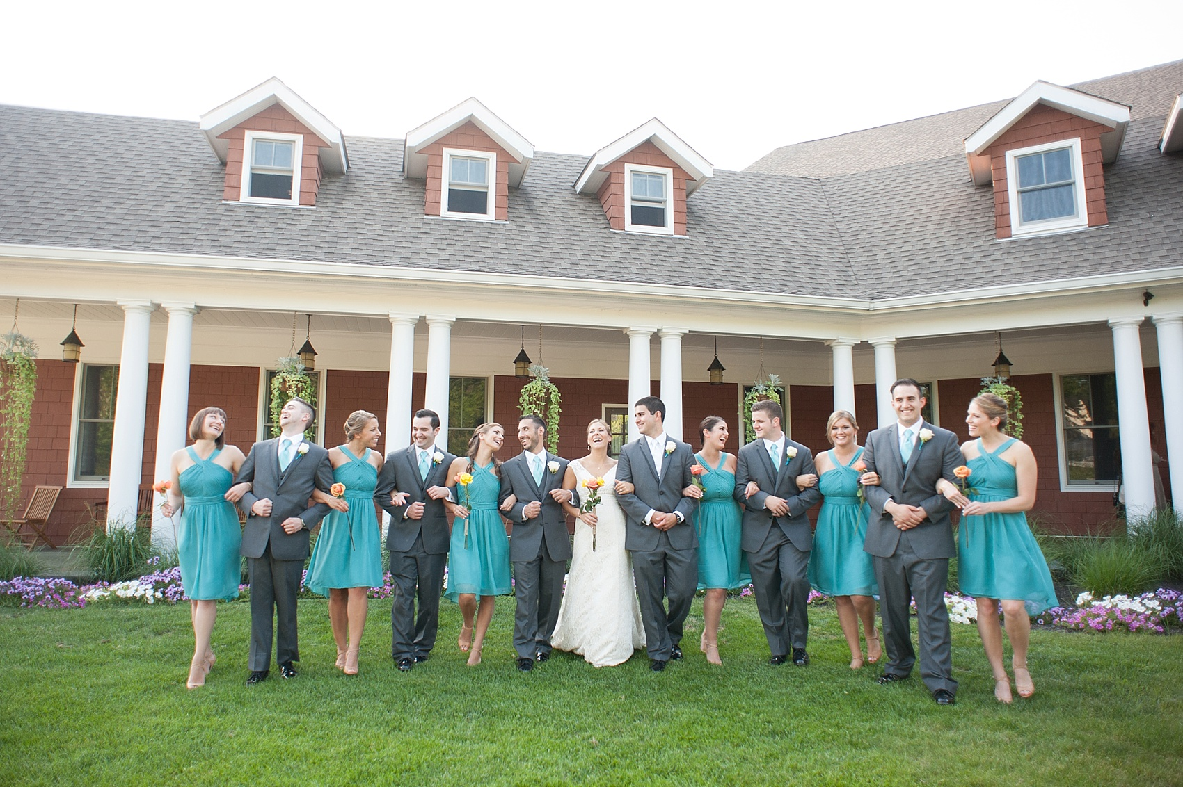 Wedding party in teal dresses and grey suits for a Hollow Brook Golf Club wedding in New York. Photos by Mikkel Paige Photography.