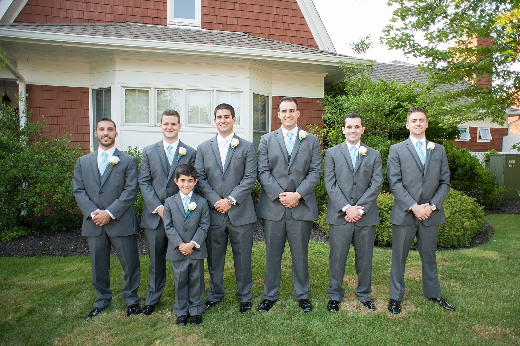 Groomsmen in grey suits for a Hollow Brook Golf Club wedding in New York. Photos by Mikkel Paige Photography.