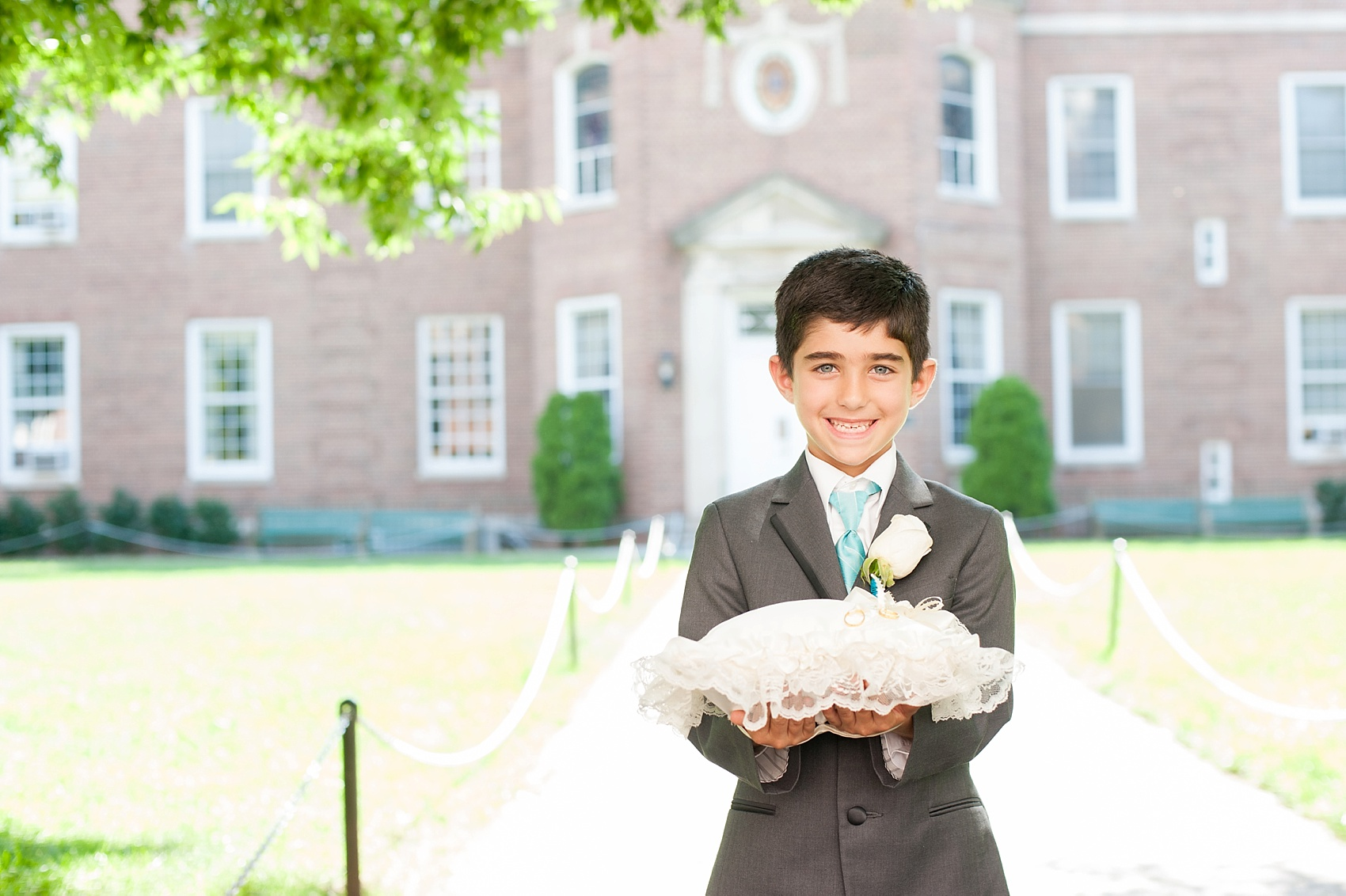 Ring bearer at a Manhattan College ceremony wedding photos in New York, by Mikkel Paige Photography.