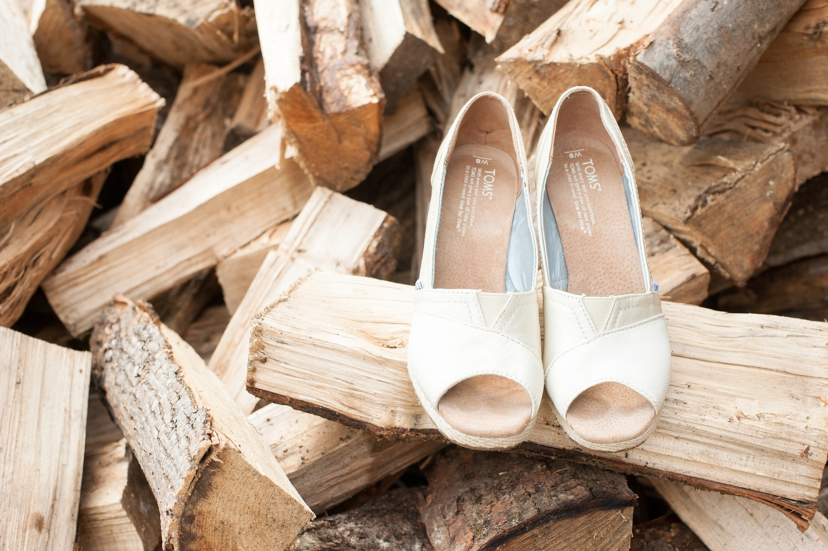 TOMS wedges for the bride at her rustic Berkshires wedding at Camp Wa Wa Segowea. Photos by Mikkel Paige Photography, destination wedding photographer.