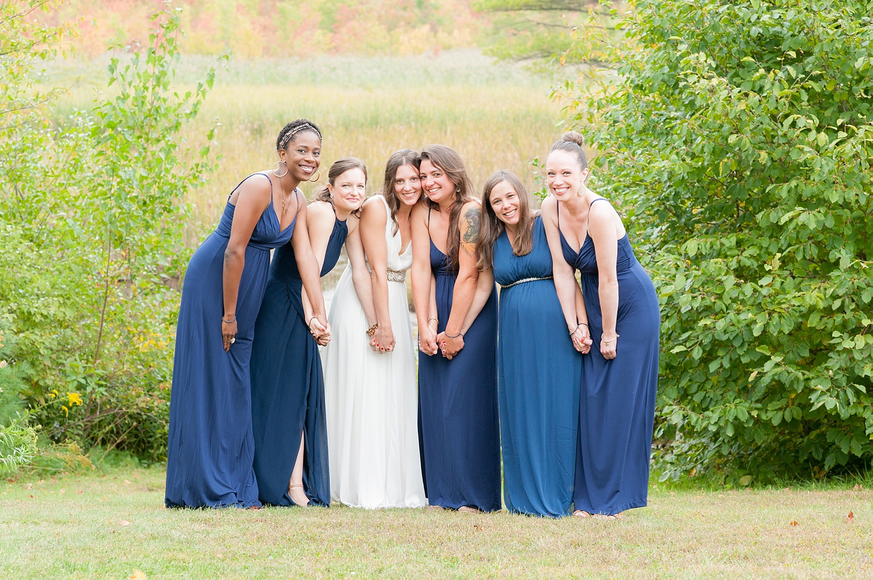Navy bridesmaids dresses for a Massachusetts Berkshires wedding at Camp Wa Wa Segowea. Photos by Mikkel Paige Photography, destination wedding photographer.
