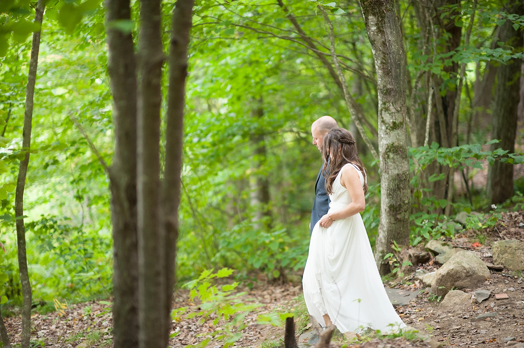 Bride and groom forest photos at their rustic Massachusetts Berkshires wedding at Camp Wa Wa Segowea. Photos by Mikkel Paige Photography, destination wedding photographer.