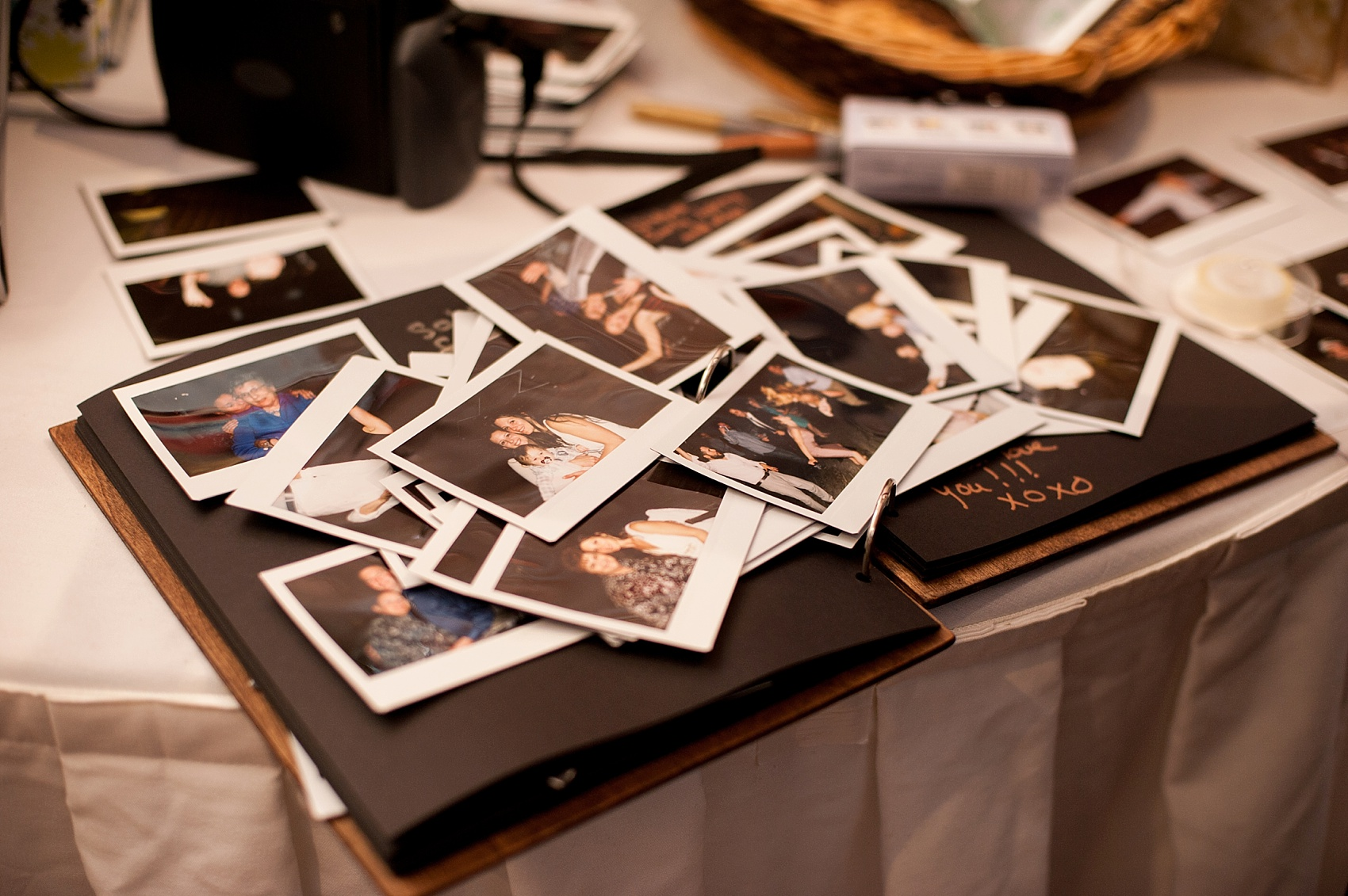 Polaroid table for a rustic Berkshires camp wedding. Photos by Massachusetts wedding photographer, Mikkel Paige Photography.