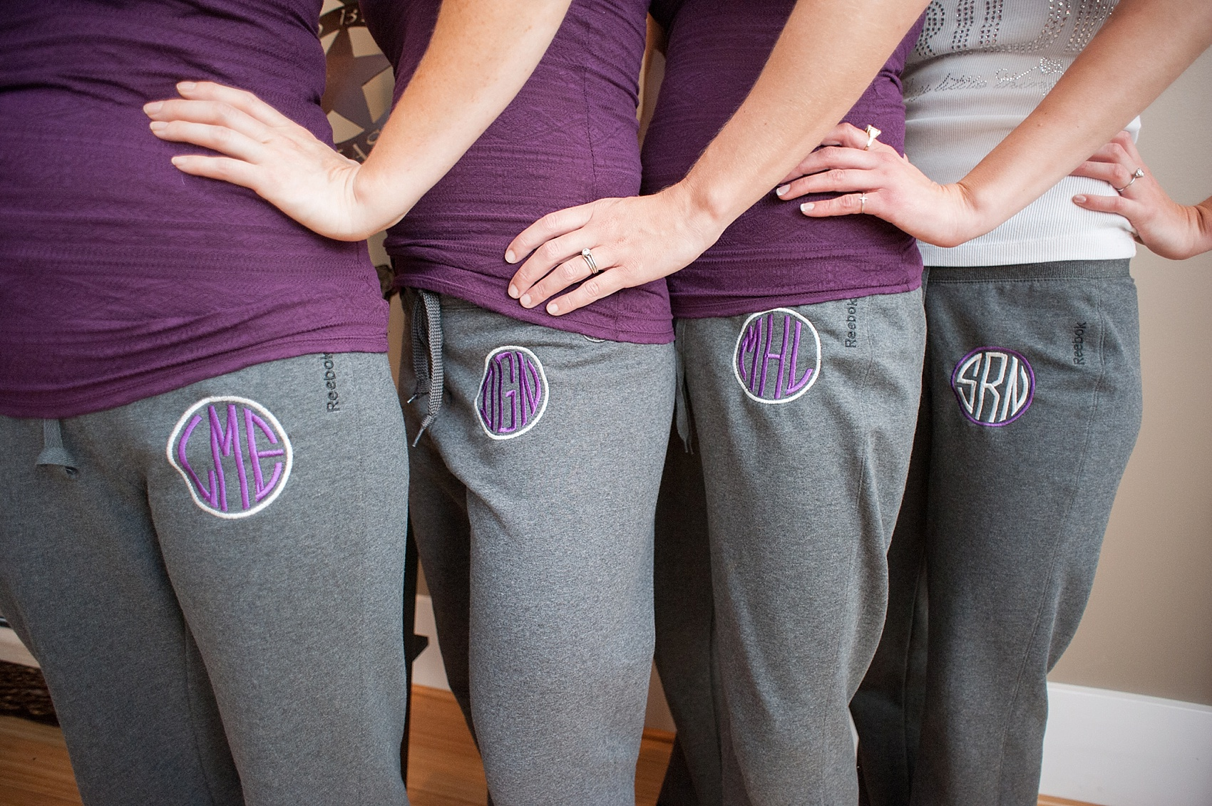 Monogrammed bridal party sweatpants for downtown Cincinnati, Ohio wedding at The Center. Photos by Mikkel Paige Photography.