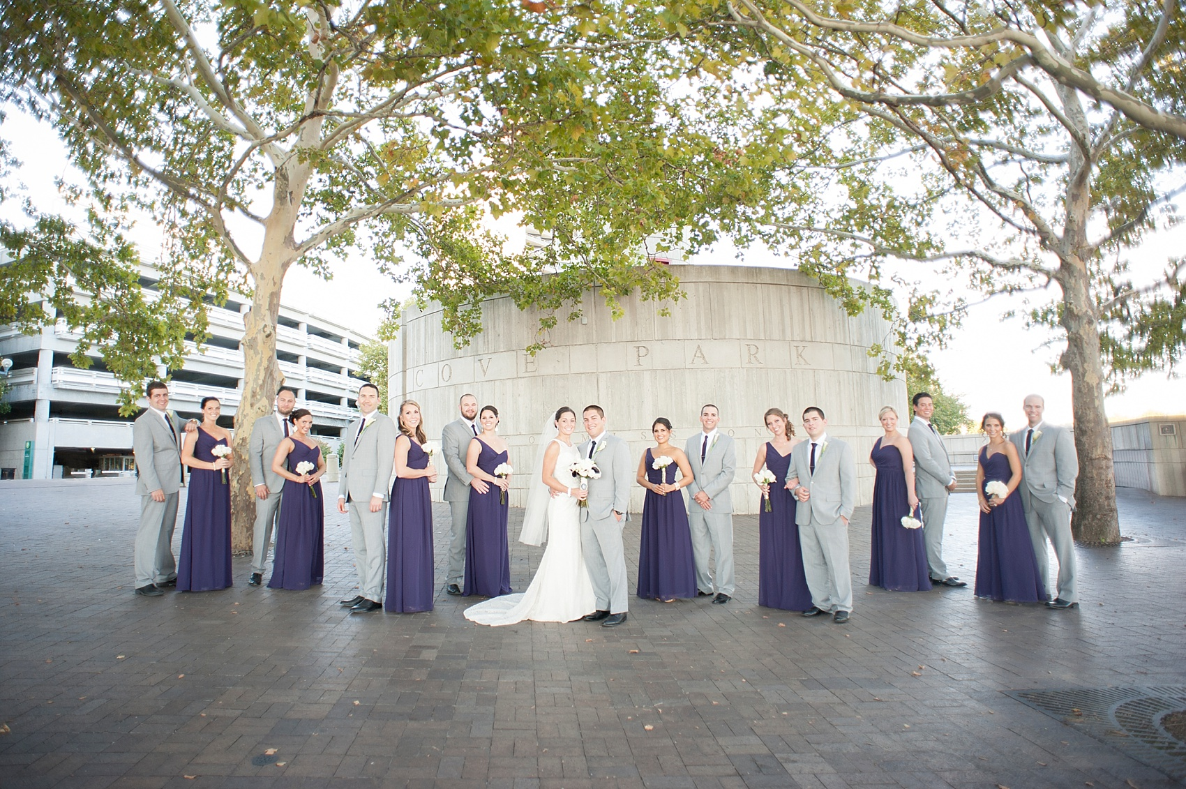 Bridal party at Sawyer Point for downtown Cincinnati, Ohio wedding at The Center. Photos by Mikkel Paige Photography.
