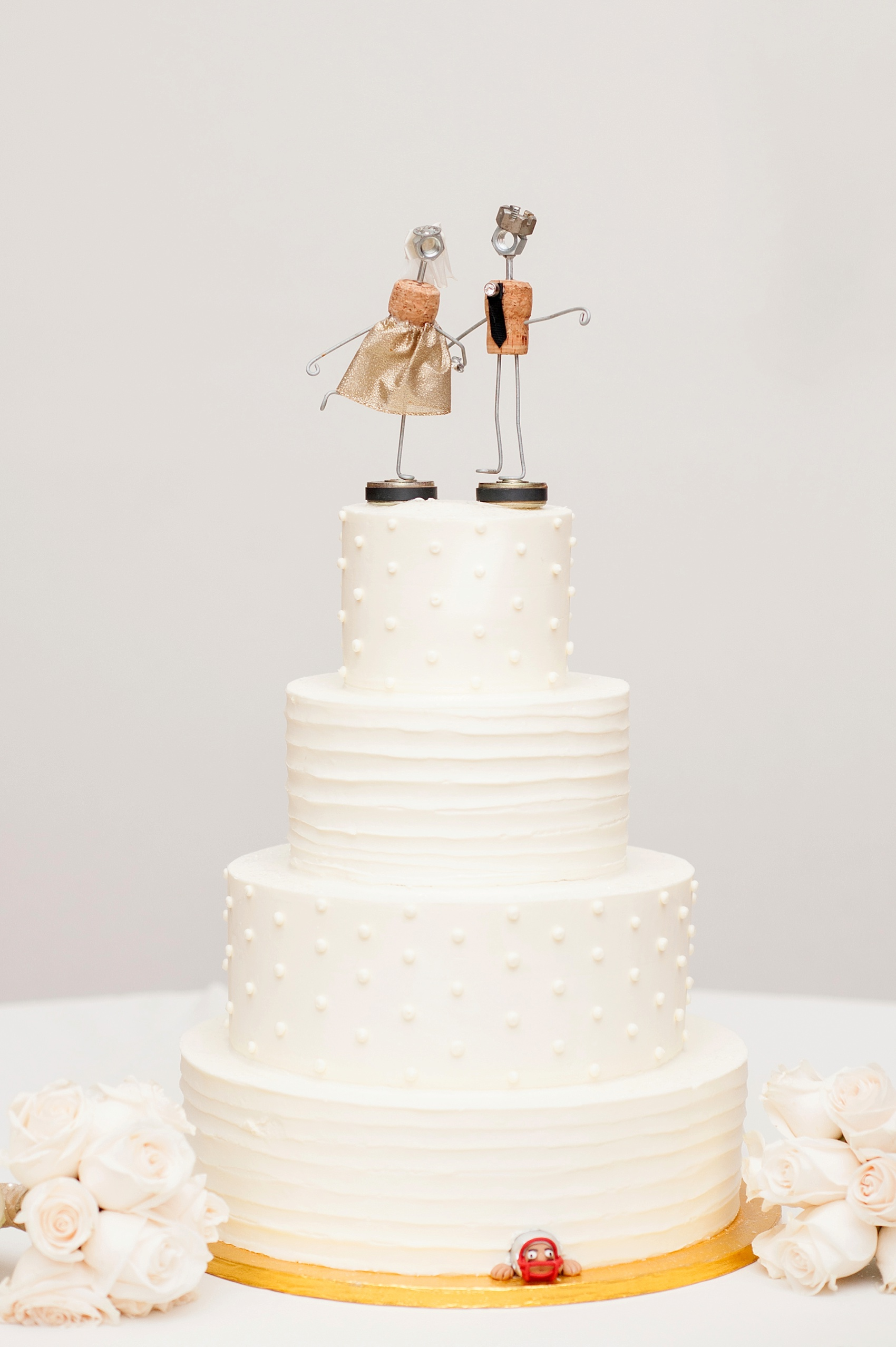 White tiered cake for a wedding at The Center, downtown Cincinnati, Ohio. Photos by Mikkel Paige Photography.