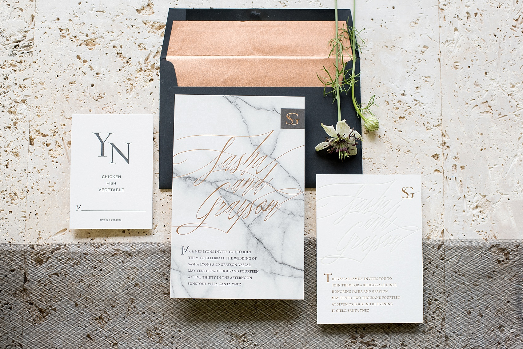 Destination wedding photographer Mikkel Paige captures a marble black, white and copper invitation suite by Bliss and Bone.