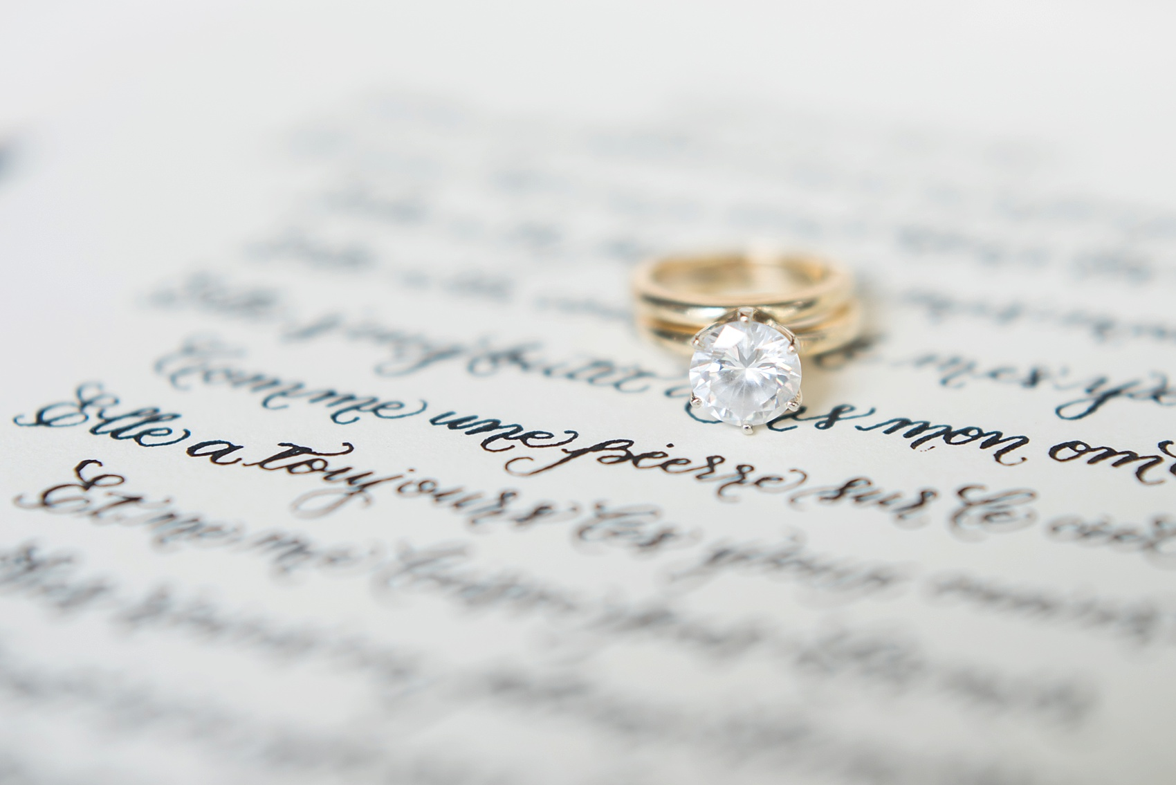 Destination wedding photographer Mikkel Paige captures a glamorous industrial bridal session in Hawaii with Burnett's Boards and Moana Events. Hand calligraphy poem and simple engagement ring.