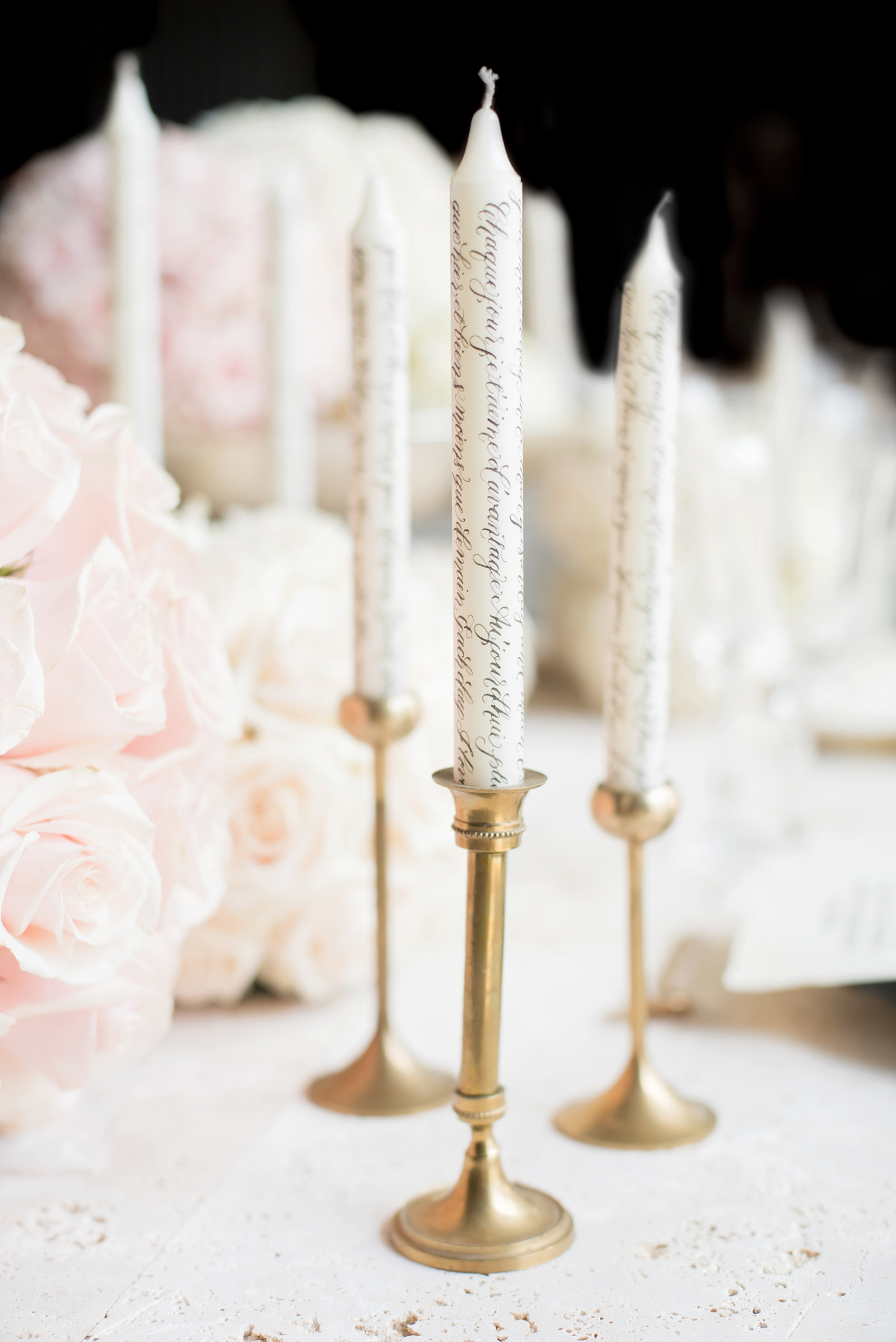 Calligraphy candles captured by destination wedding photographer Mikkel Paige captures a glamorous industrial bridal session in Hawaii with Burnett's Boards and Moana Events.