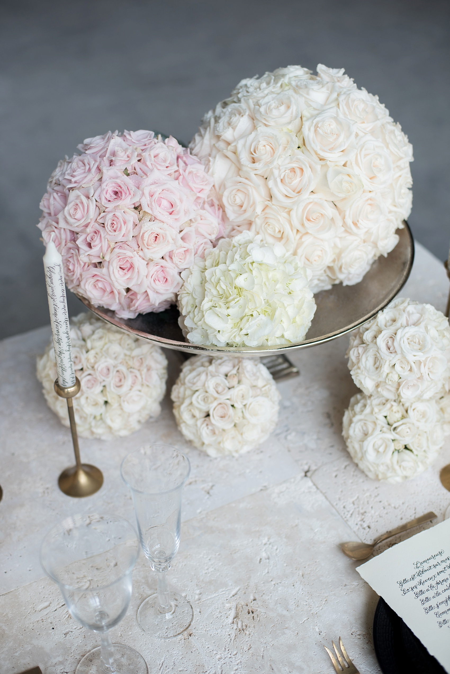 Destination wedding photographer Mikkel Paige captures a glamorous industrial bridal session in Hawaii with Burnett's Boards and Moana Events. White and pink pomander flower spheres adorn the sweetheart table.