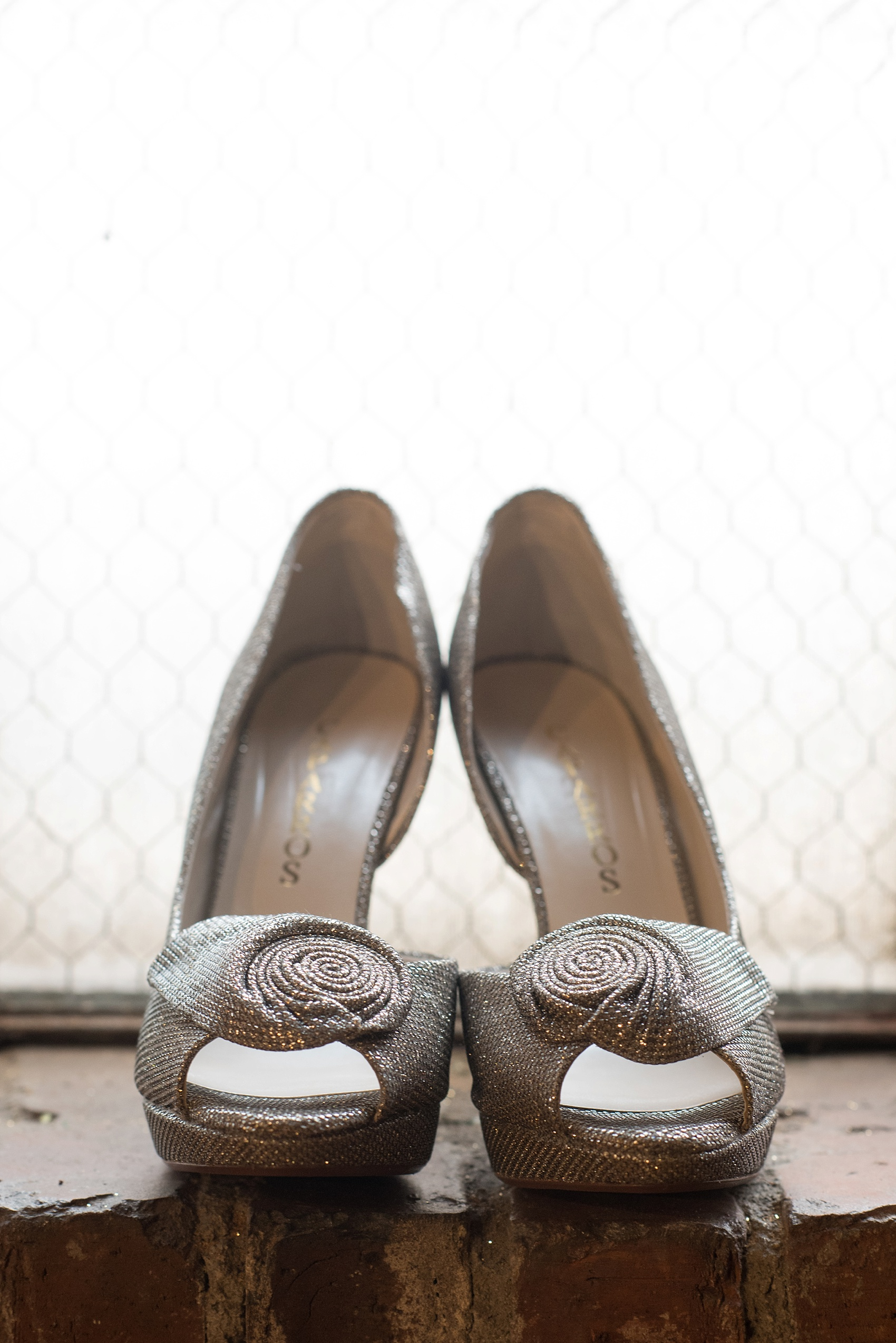 Raleigh wedding photographer Mikkel Paige Photography captures sparkly gold wedding shoes at The Stockroom.