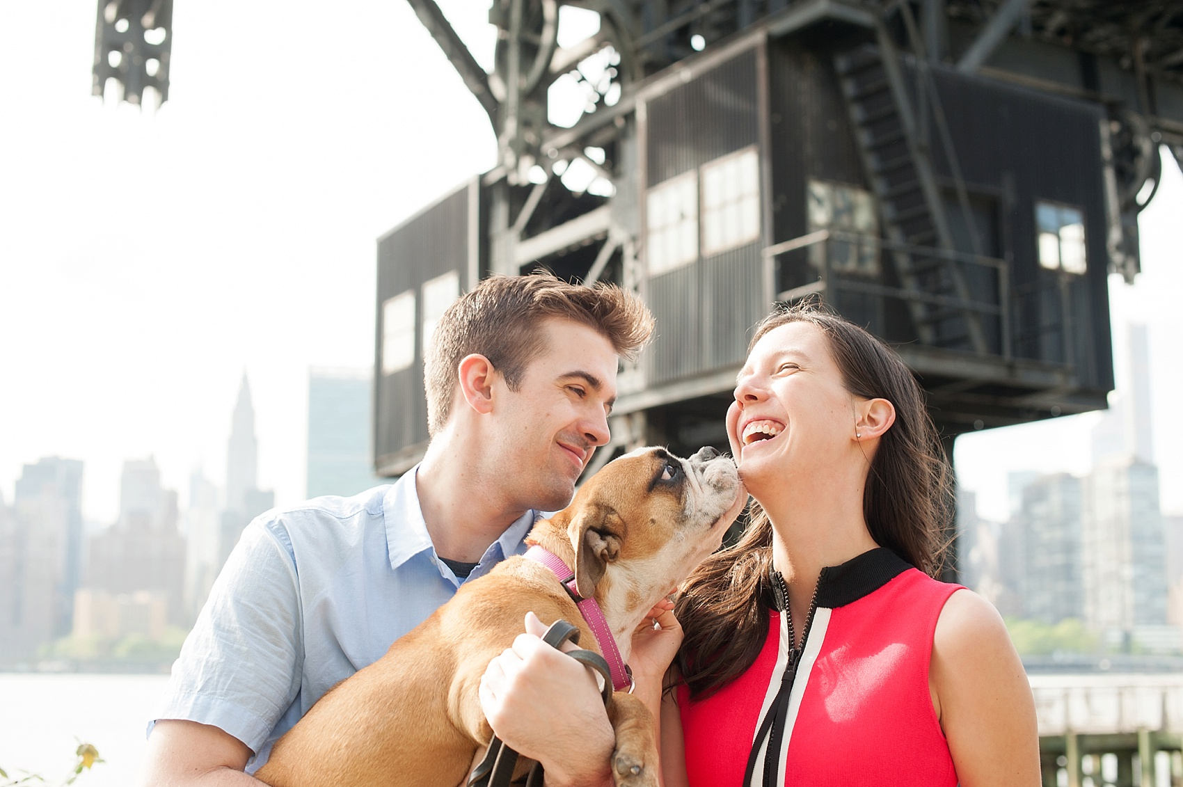 Long Island City waterfront engagement session at Gantry State Park by Mikkel Paige Photography, NYC wedding photographer. Their English Bulldog puppy came along for the photo session!