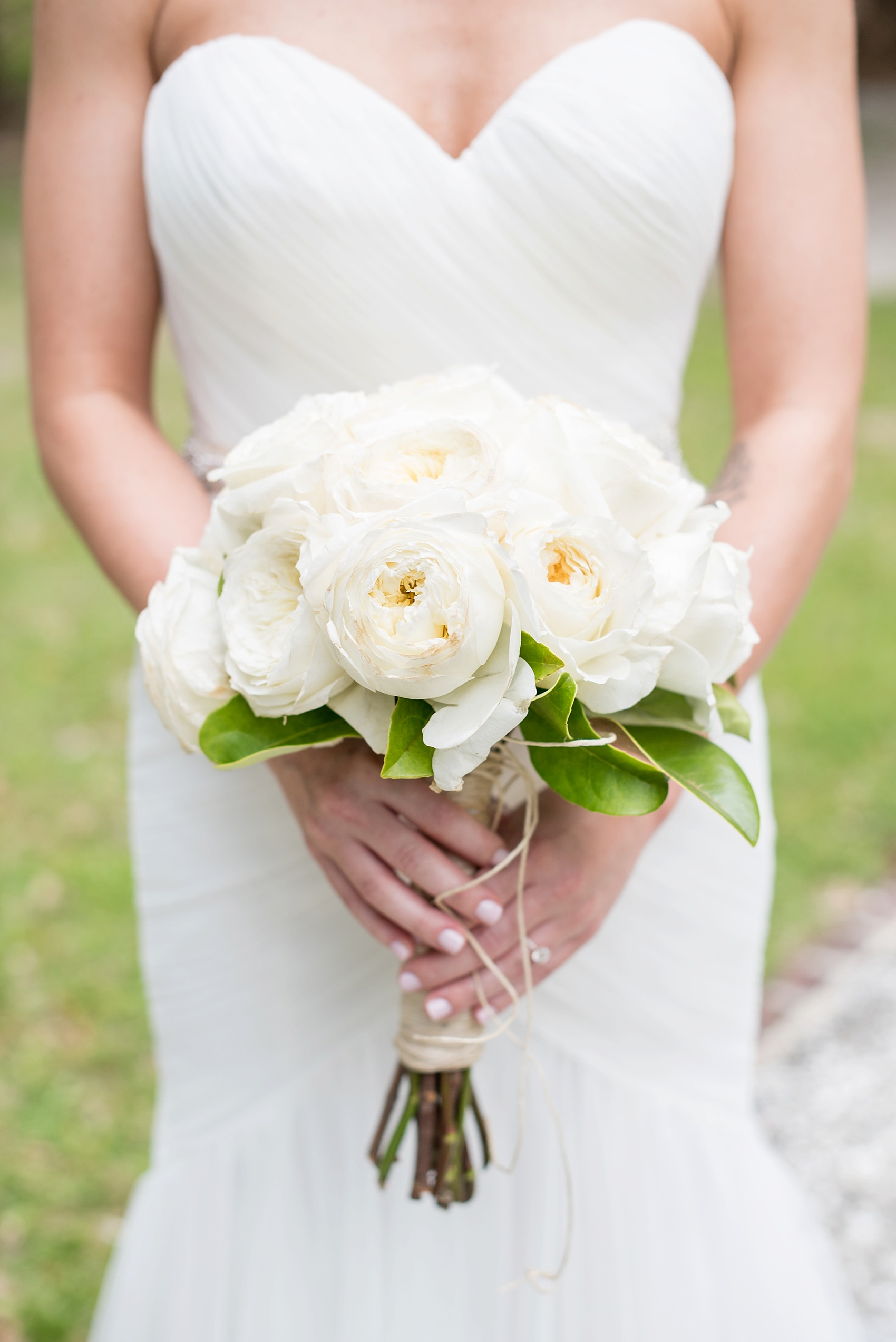White rose bouquet with jute twine wrapped around its stems for a southern wedding. Photo by Mikkel Paige in Hilton Head, Haig Point, South Carolina.