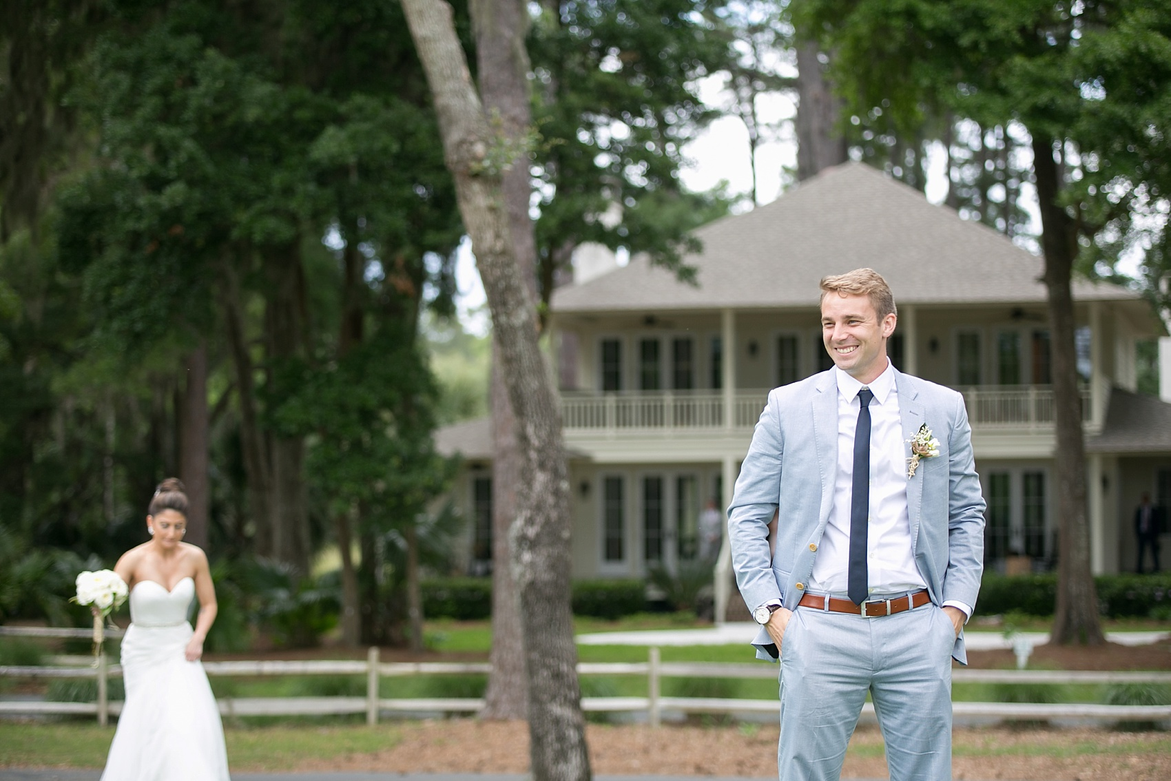 First look for the bride and groom on a golf course in Haig Point, South Carolina, off the coast of Hilton Head. Photos by Mikkel Paige Photography.