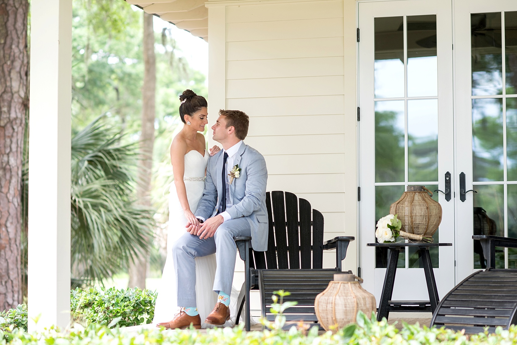 Bride and groom photos on a southern wrap around porch in Haig Point, South Carolina, off the coast of Hilton Head. Photos by Mikkel Paige Photography.