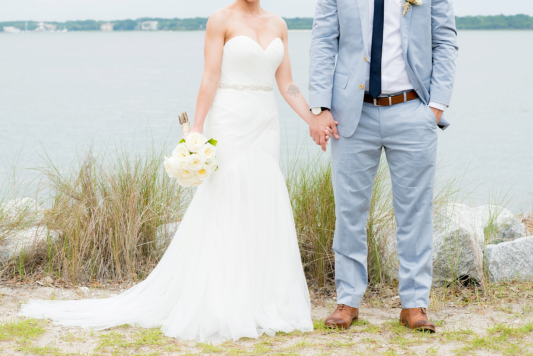 Bride and groom waterfront photos in Haig Point, South Carolina, off the coast of Hilton Head. Photos by Mikkel Paige Photography.
