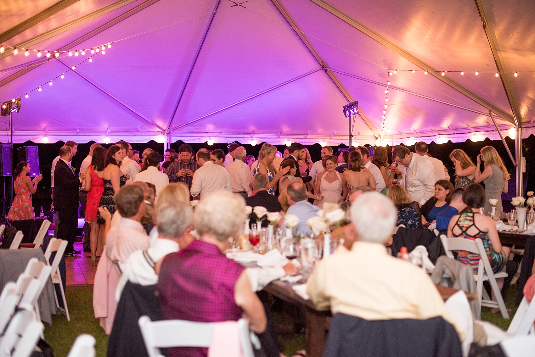 Tented southern wedding reception at Haig Point in South Carolina, off the coast of Hilton Head. Photos by Mikkel Paige Photography.