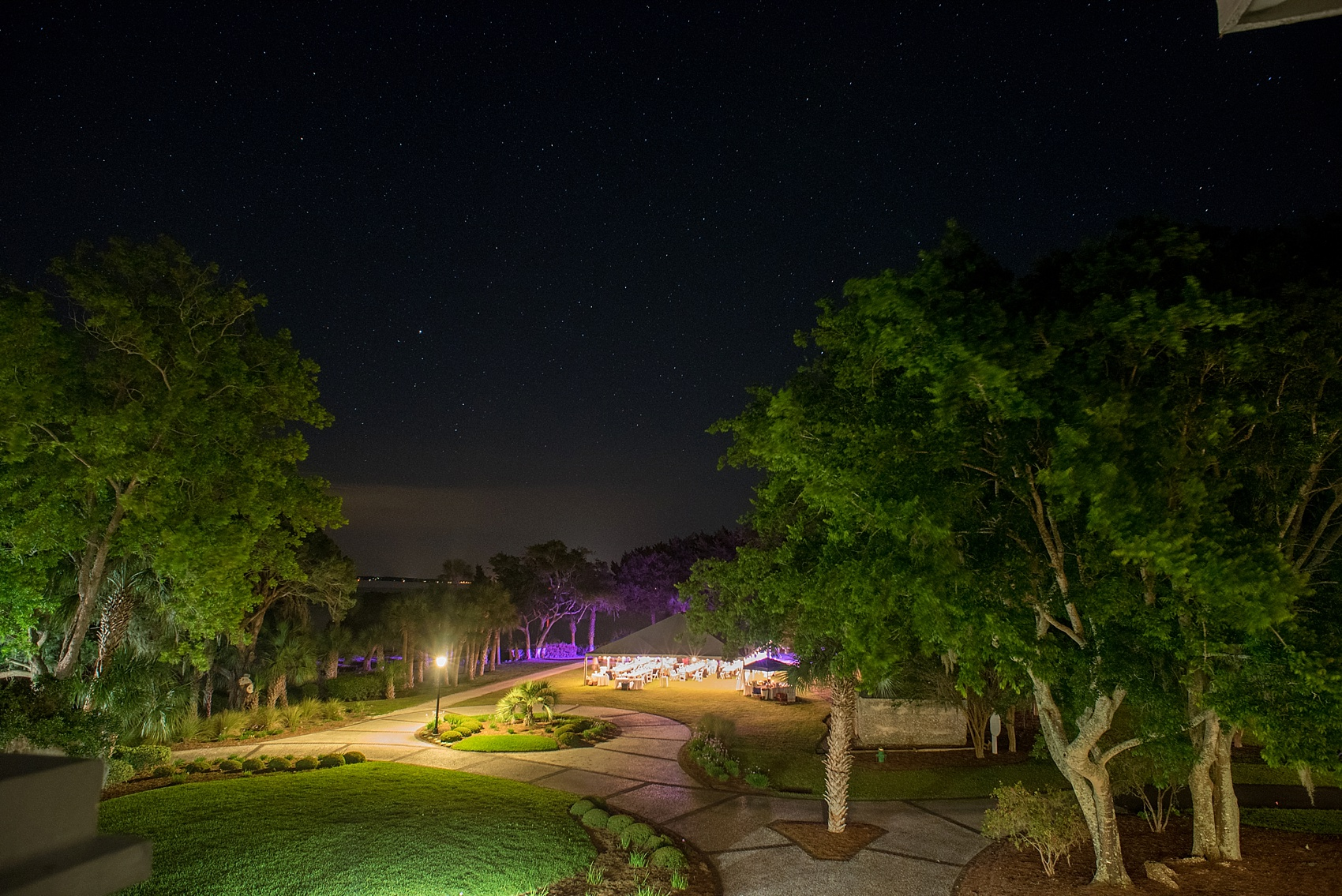 Night photography with starry skies at a tented wedding reception at Haig Point in South Carolina, off the coast of Hilton Head. Photos by Mikkel Paige Photography.