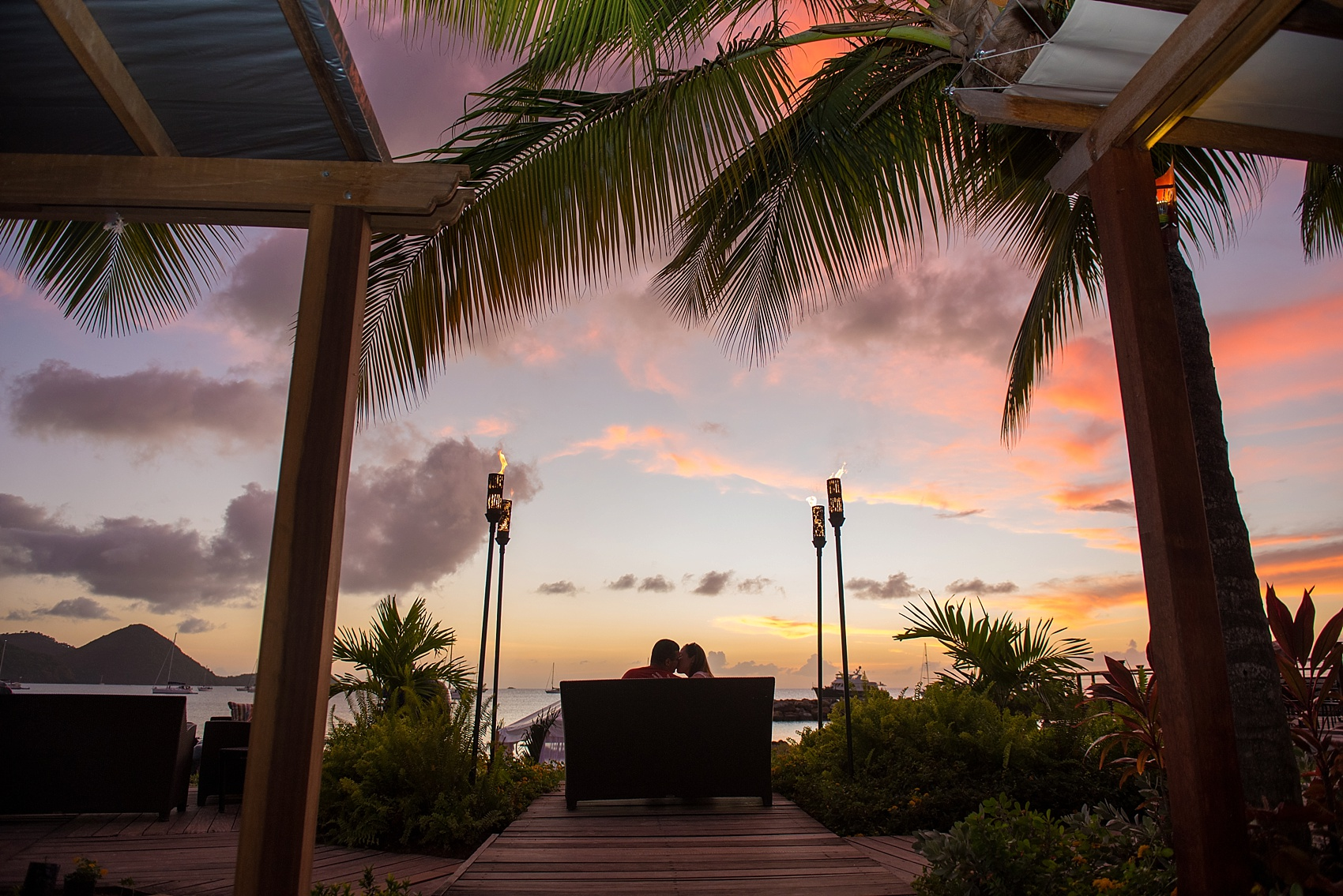 Sunset photo on St. Lucia Proposal ideas - beachside romance at an oceanfront dinner at The Landings resort. Images by destination wedding photographer Mikkel Paige Photography.