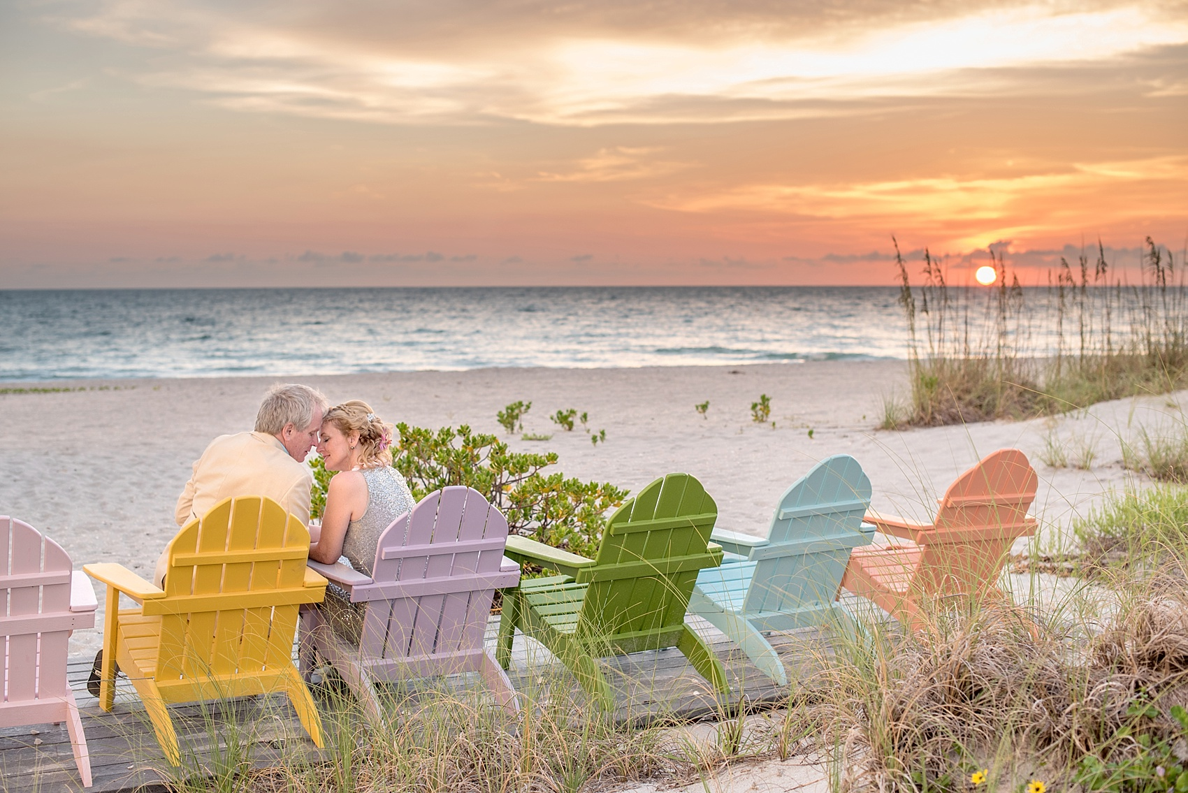 Captiva Island small wedding sunset beach photos of the bride and groom. Photos by Mikkel Paige Photography.
