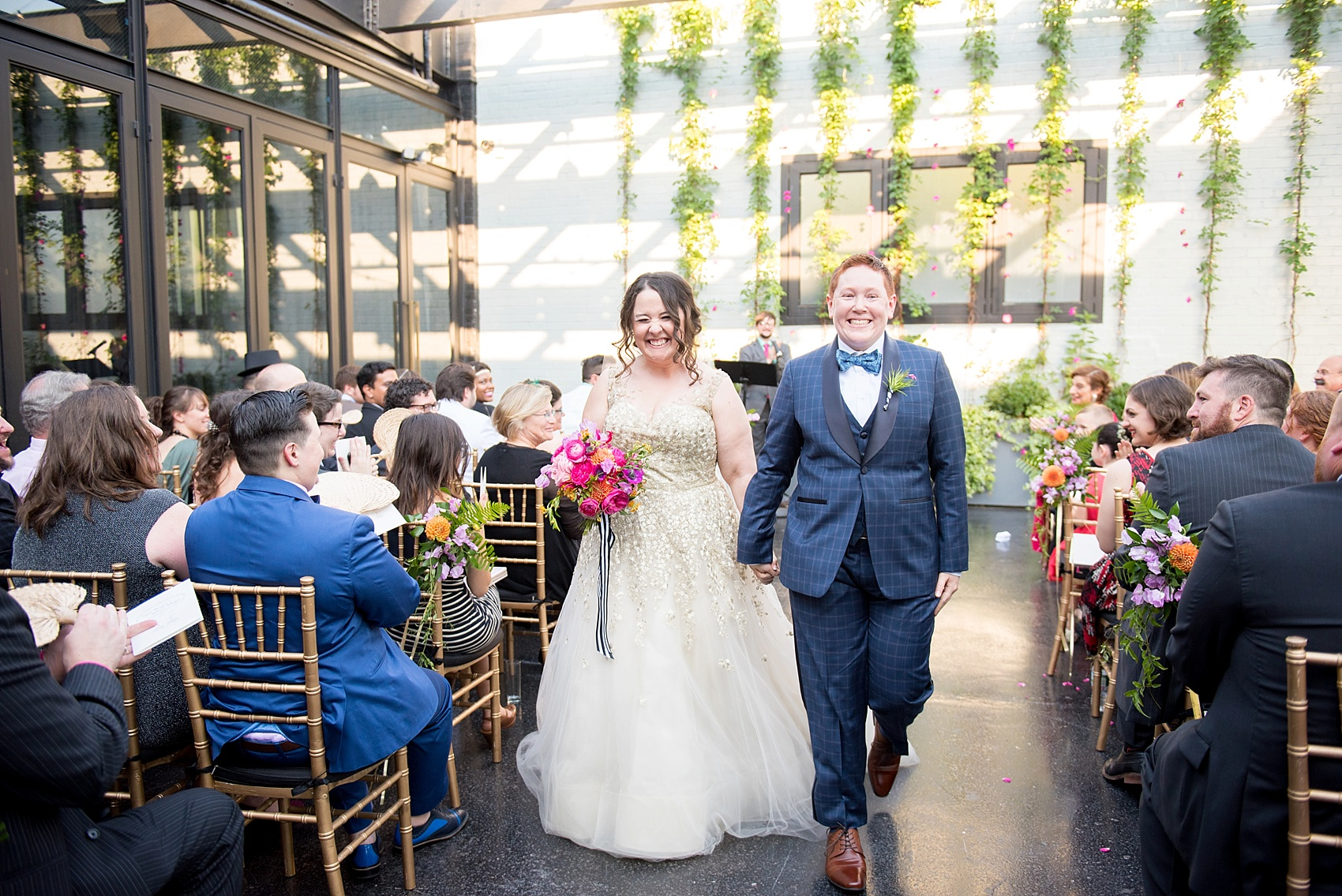 501 Union lesbian wedding ceremony with floral backdrop. Photos by Mikkel Paige Photography, in Brooklyn, NYC. Planning by Ashley M Chamblin Events.