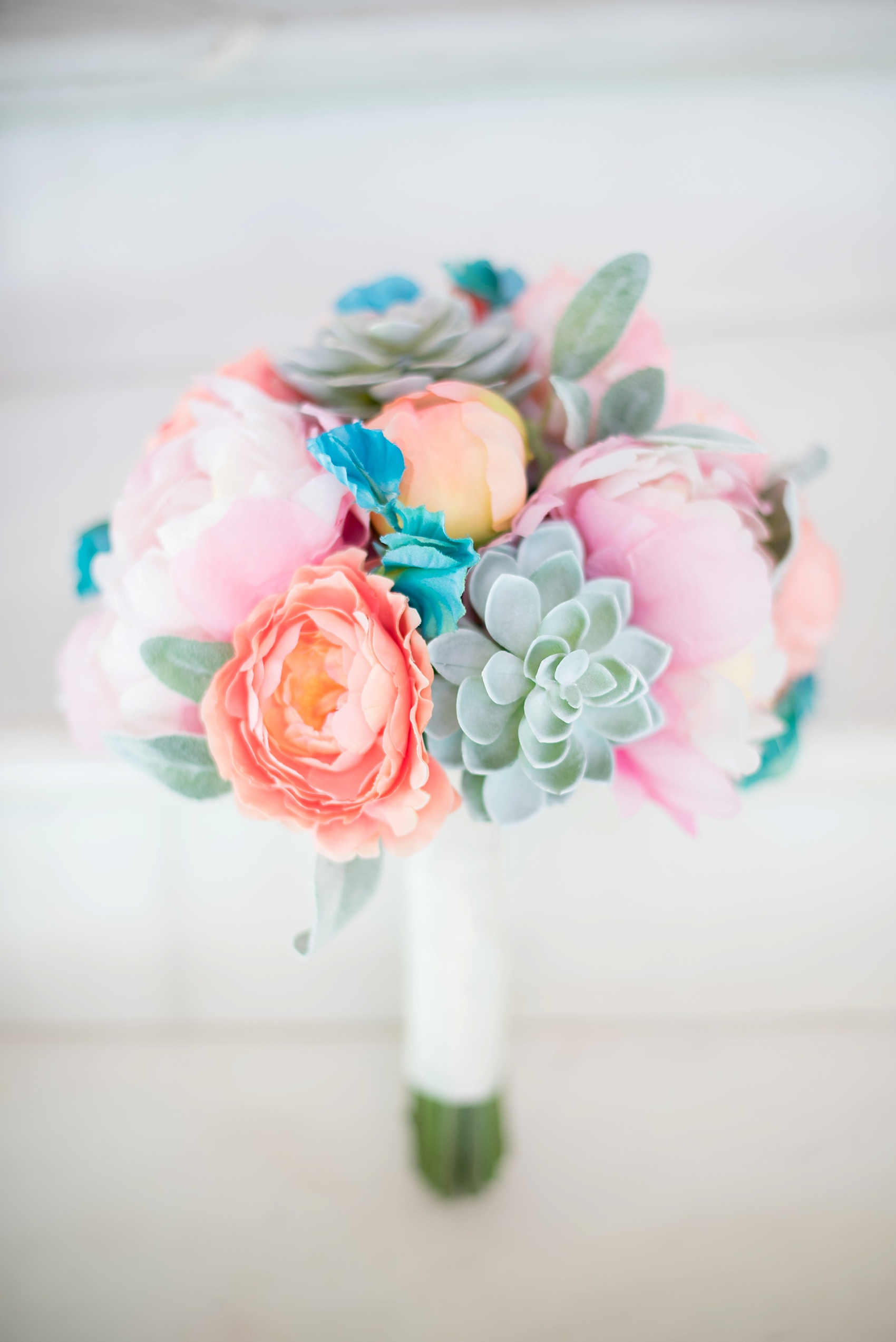 Iberostar Jamaica wedding photos, bride's bouquet with peonies and succulents. Images by Mikkel Paige Photography.