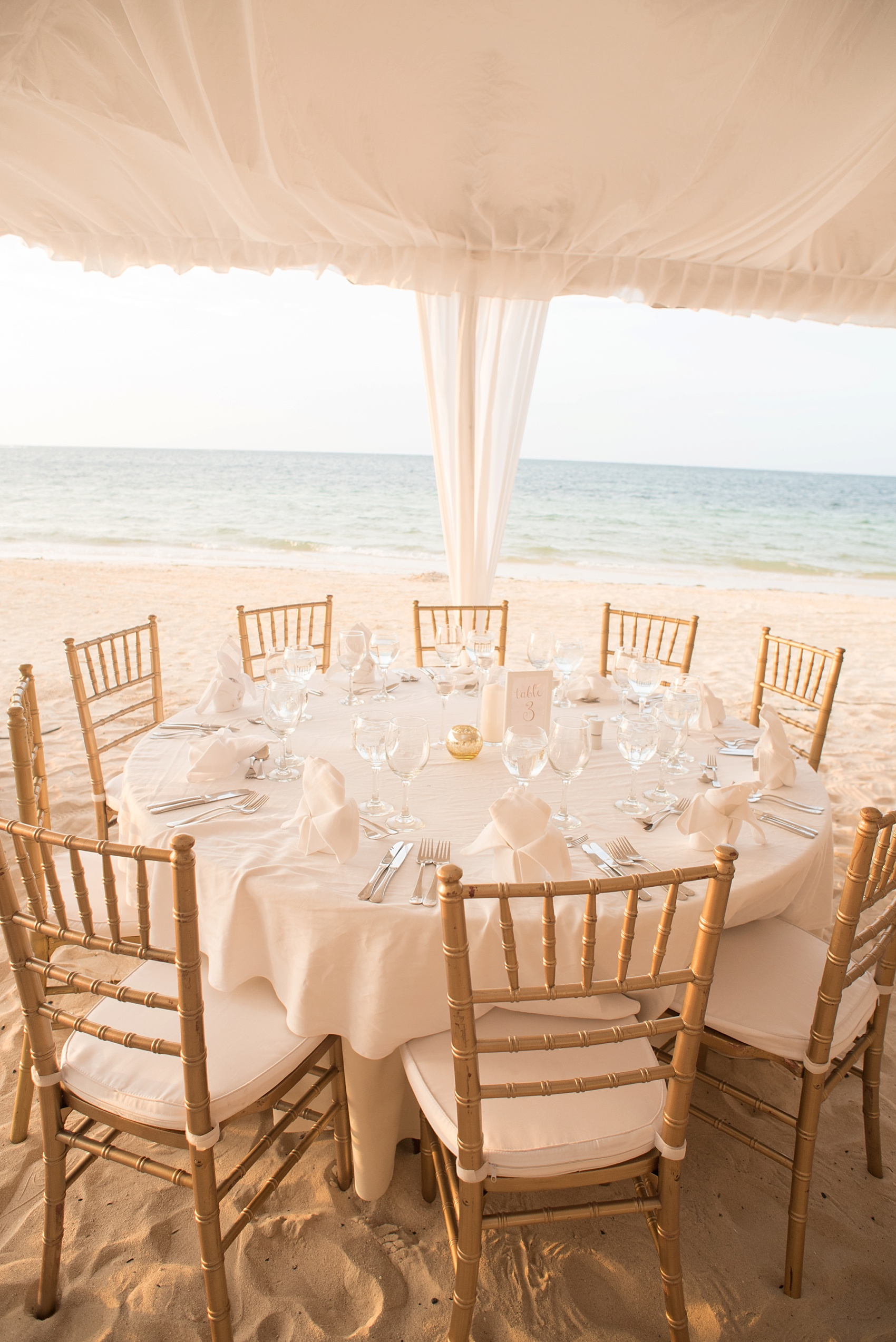 Iberostar Jamaica tented wedding reception table photos. Images by Mikkel Paige Photography.