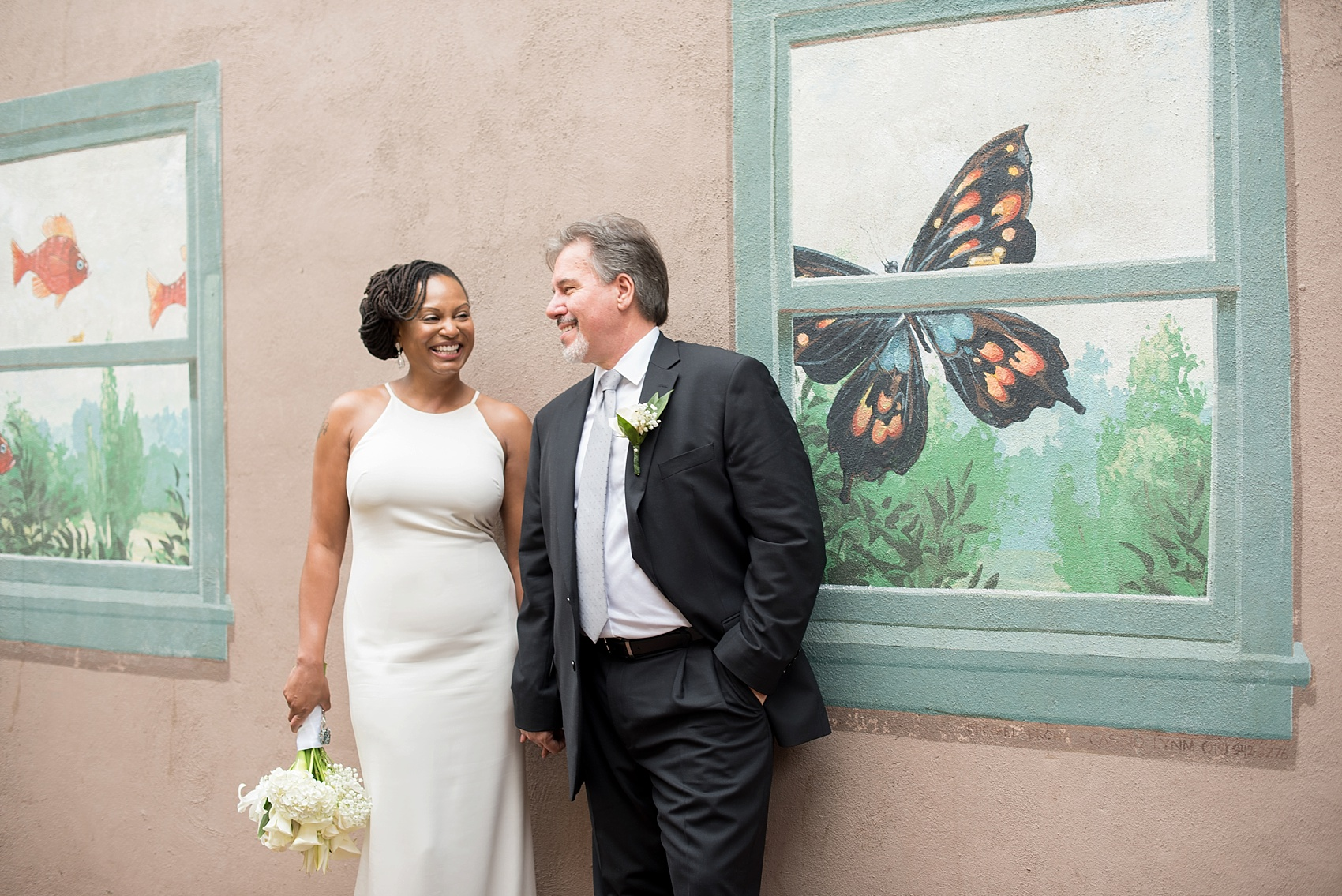 Downtown Raleigh mixed race wedding. Photos by Mikkel Paige Photography. Photos of the bride and groom.