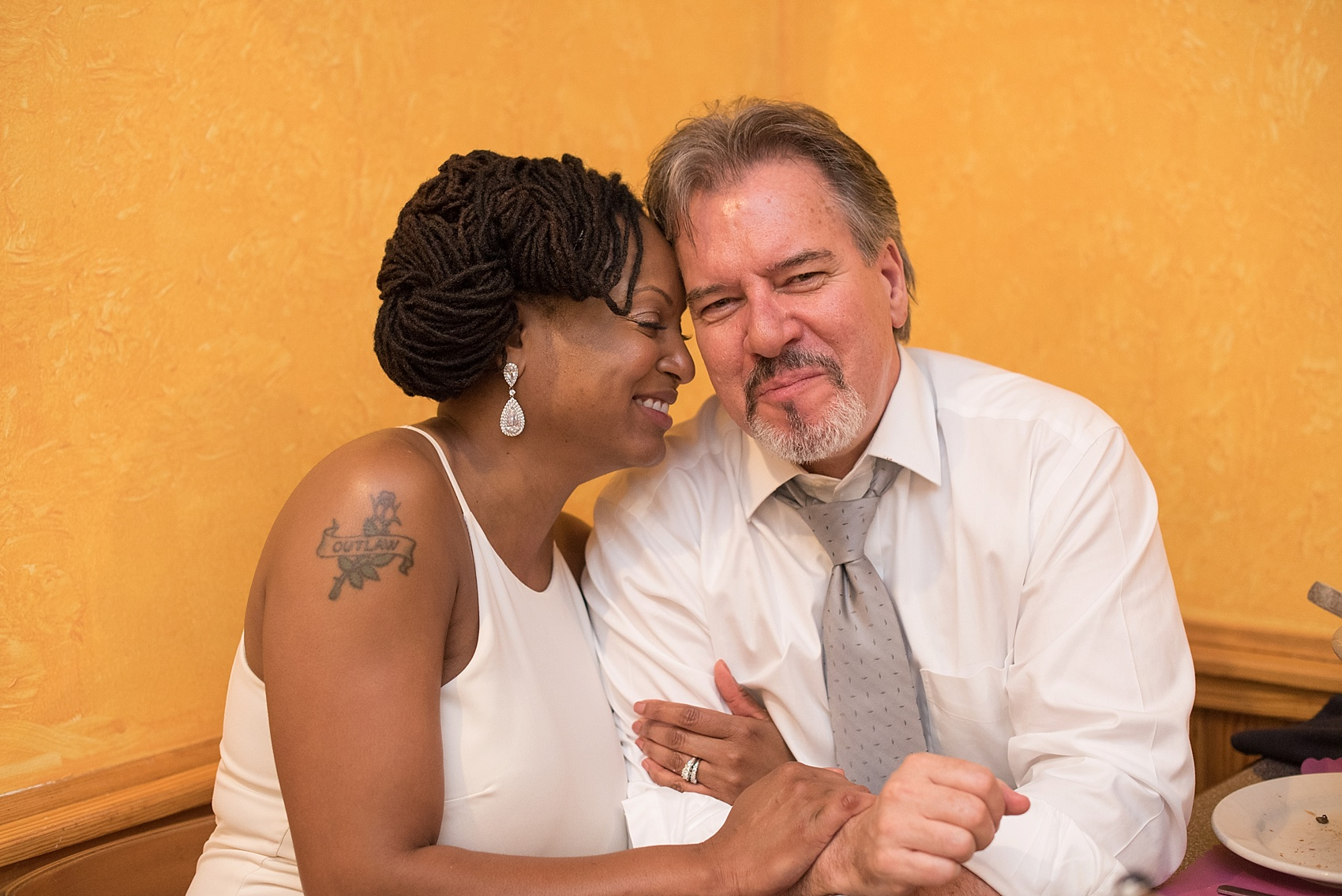 Downtown Raleigh, NC mixed race wedding. Photos by Mikkel Paige Photography. Photos of the bride and groom.