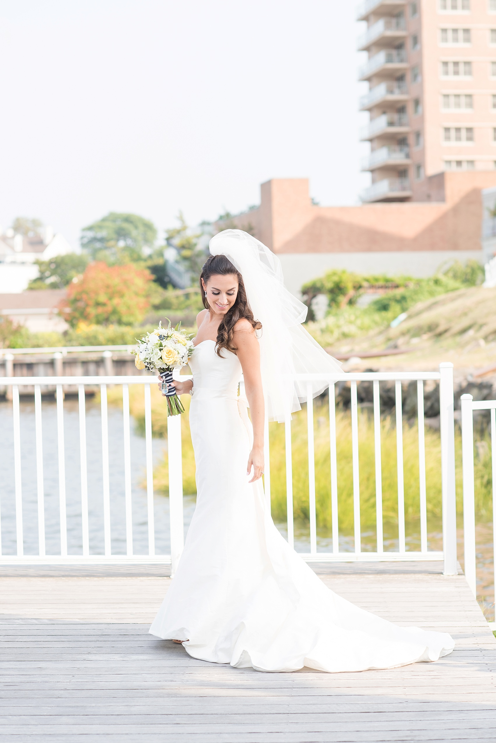 Bride image on the waterfront at the Molly Pitcher Inn. Photo by Mikkel Paige Photography.
