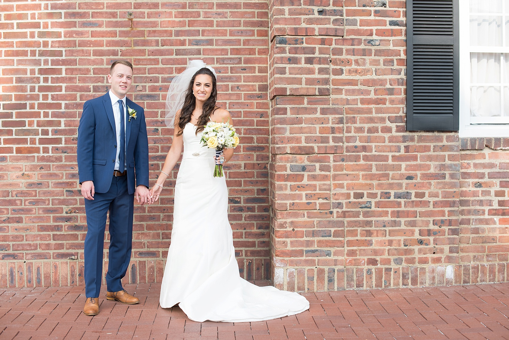 Bride and groom in New Jersey for their nautical wedding at the Molly Pitcher Inn. Photo by Mikkel Paige Photography.