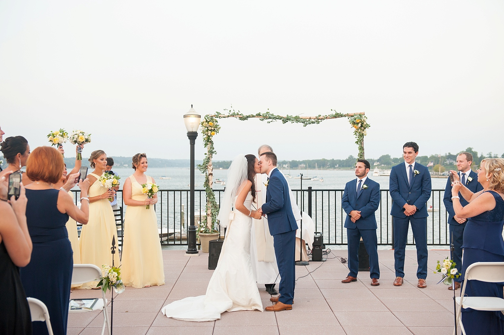 New Jersey waterfront wedding ceremony for a nautical day at the Molly Pitcher Inn. Photo by Mikkel Paige Photography.