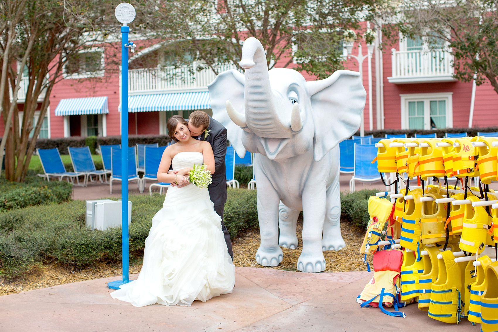 Walt Disney World wedding pictures at the Boardwalk venue, including a waterfront ceremony and Dance Hall reception near Epcot. These photos will give you unique, fun ideas from Glow in the Dark invitations to their Dole Whip flavored cake! Want to see more? Click through to Mikkel Paige Photography for more inspiration from this bride and groom's colorful day! #DisneyWedding #mikkelpaige #disneysboardwalk #DisneyWeddingVenue #DisneyBride #DisneyFan #MickeyEars