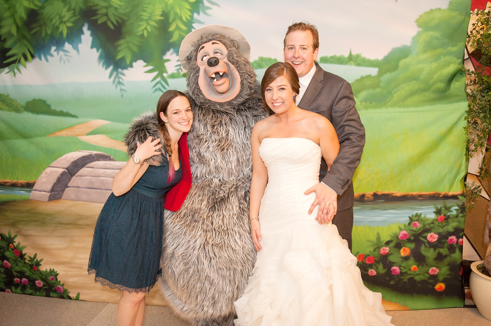 Walt Disney World wedding pictures at the Boardwalk venue, including a waterfront ceremony and Dance Hall reception near Epcot. These photos will give you unique, fun ideas from Glow in the Dark invitations to their Dole Whip flavored cake! Want to see more? Click through to Mikkel Paige Photography for more inspiration from this bride and groom's colorful day! #DisneyWedding #mikkelpaige #disneysboardwalk #DisneyWeddingVenue #DisneyBride #DisneyFan #MickeyEars #CountryBearJamboree