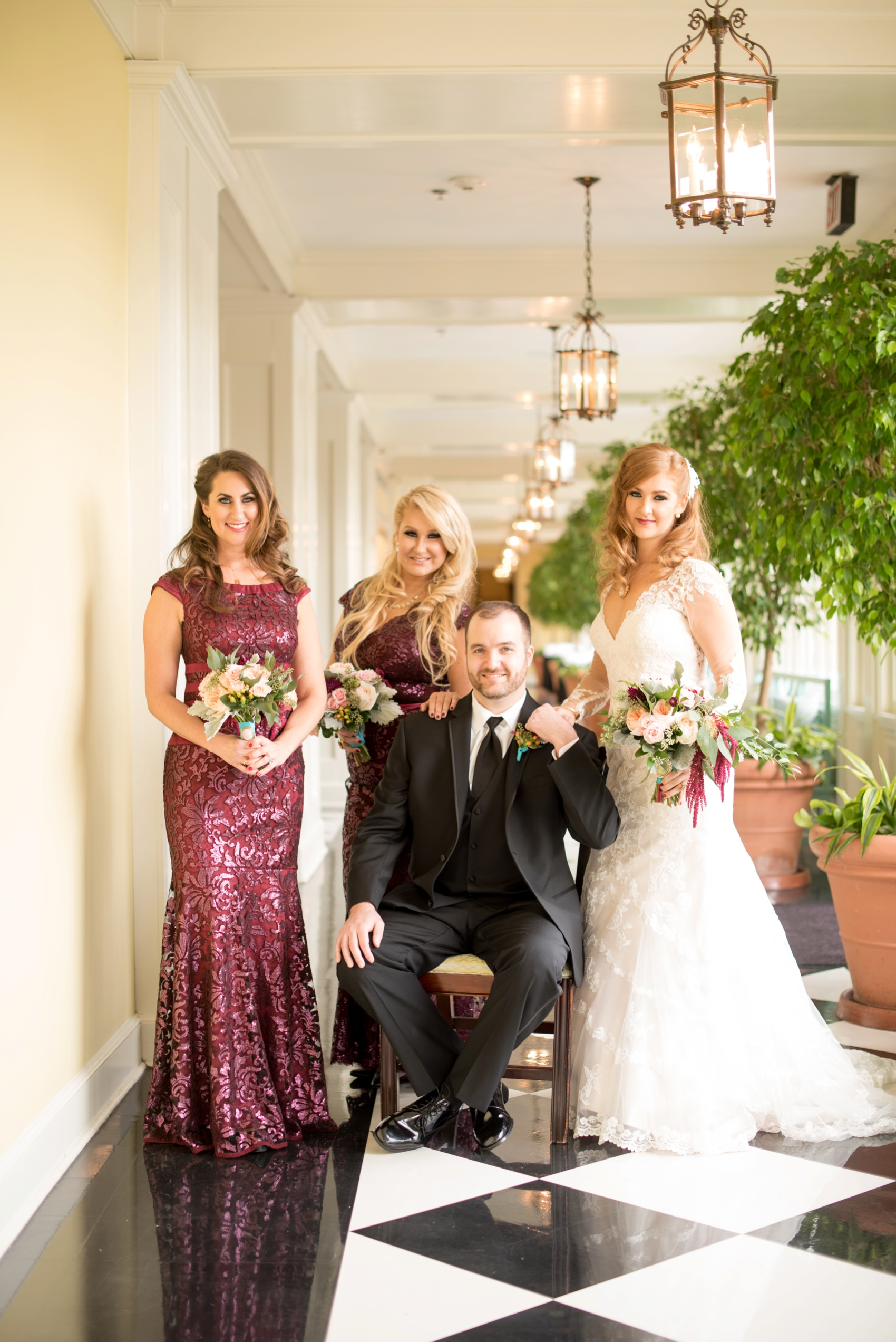 The Carolina Inn wedding photos by Mikkel Paige Photography, Raleigh wedding photographer. Planning by A Swanky Affair and flowers by Tres Bella. Unique bridal party photo with vintage elegance.