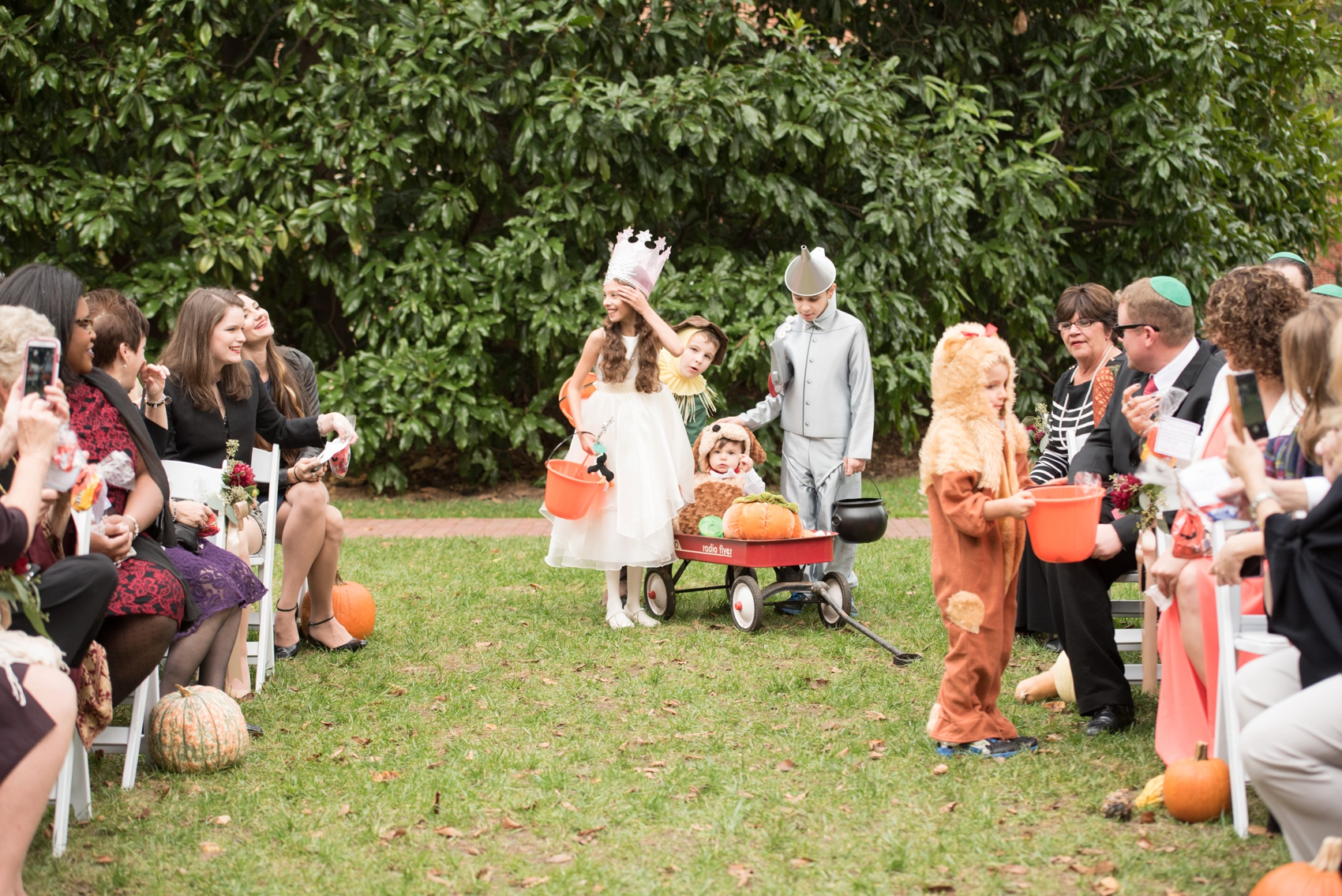The Carolina Inn wedding photos by Mikkel Paige Photography, Raleigh wedding photographer. Planning by A Swanky Affair and flowers by Tre Bella for a fall pumpkin Halloween inspired outdoor ceremony with The Wizard of Oz ring bearers and flower girl.