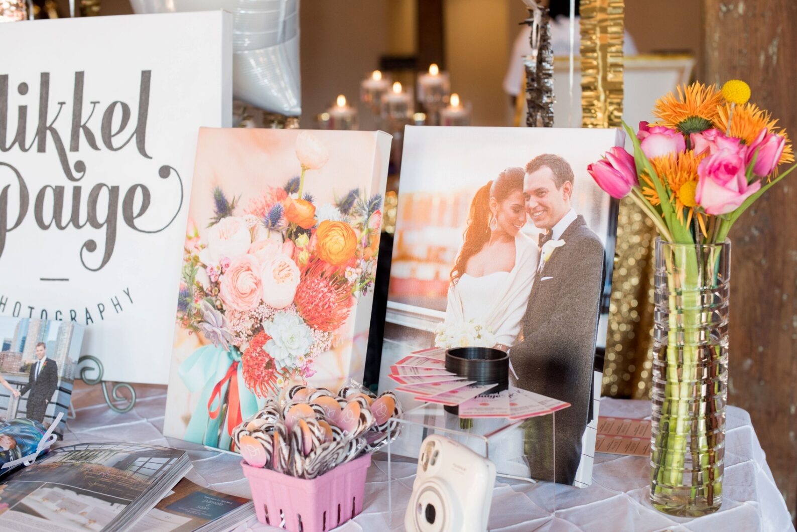 The Cloth Mill North Carolina wedding vendor showcase. Photographer Mikkel Paige Photography's table display with canvases and business cards.