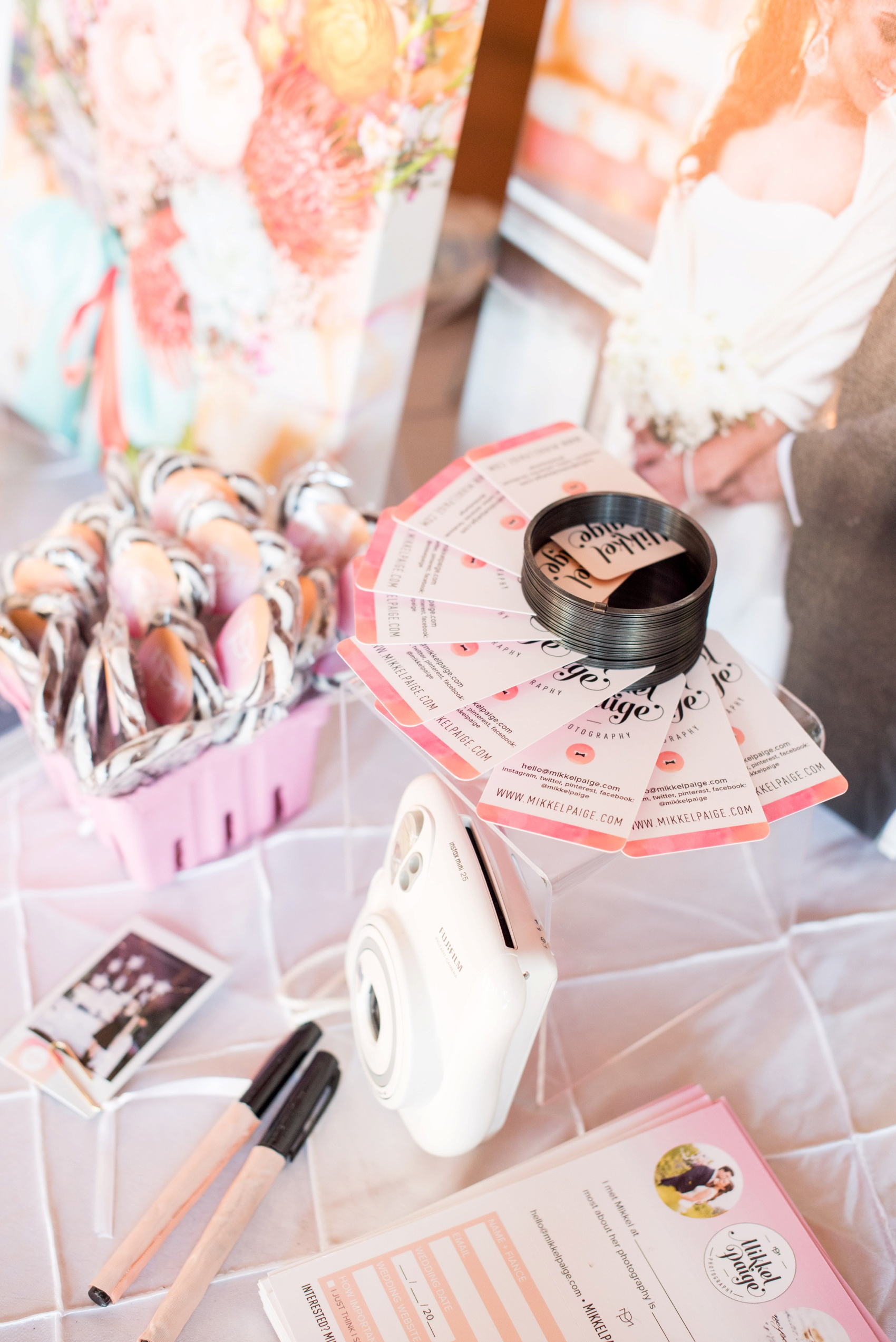 The Cloth Mill North Carolina wedding vendor showcase. Photographer Mikkel Paige Photography's table display with Instax and business card display.