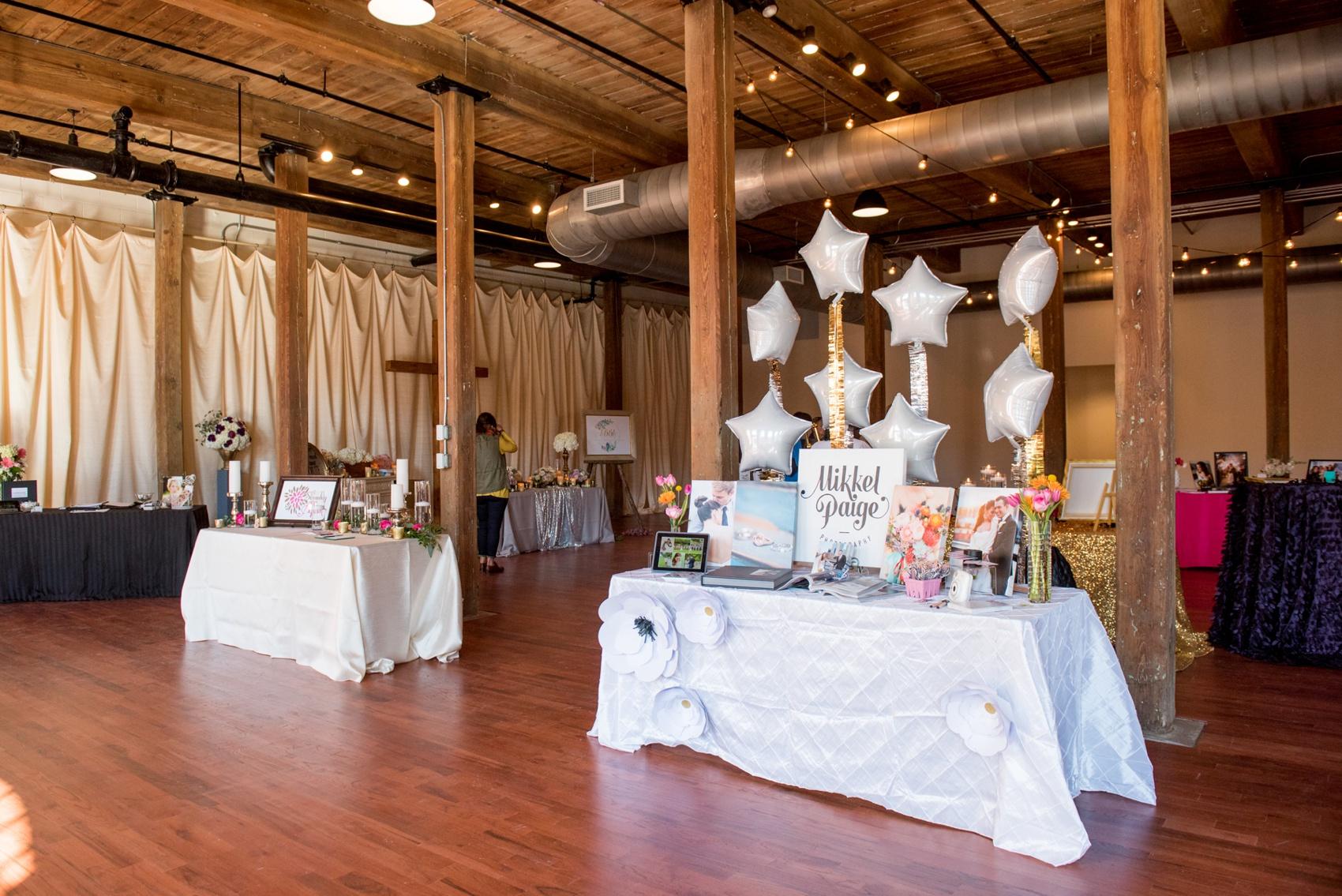 The Cloth Mill North Carolina wedding vendor showcase. Photographer Mikkel Paige Photography's table display.