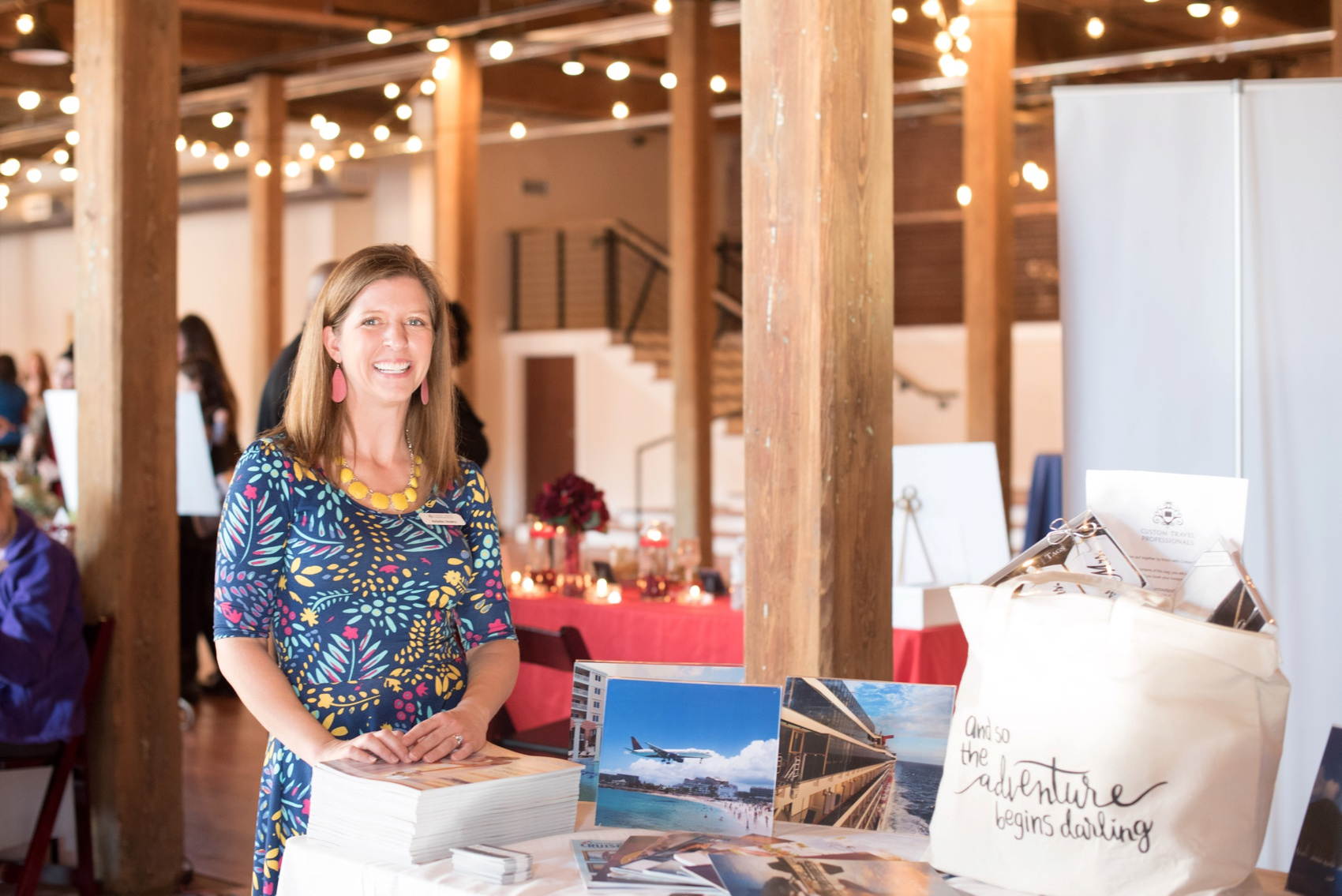 The Cloth Mill North Carolina wedding vendor showcase. Raleigh, Durham and Hillsborough vendors at a rustic, modern location. Table display of travel agent Custom Travel Professionals for honeymoon planning.