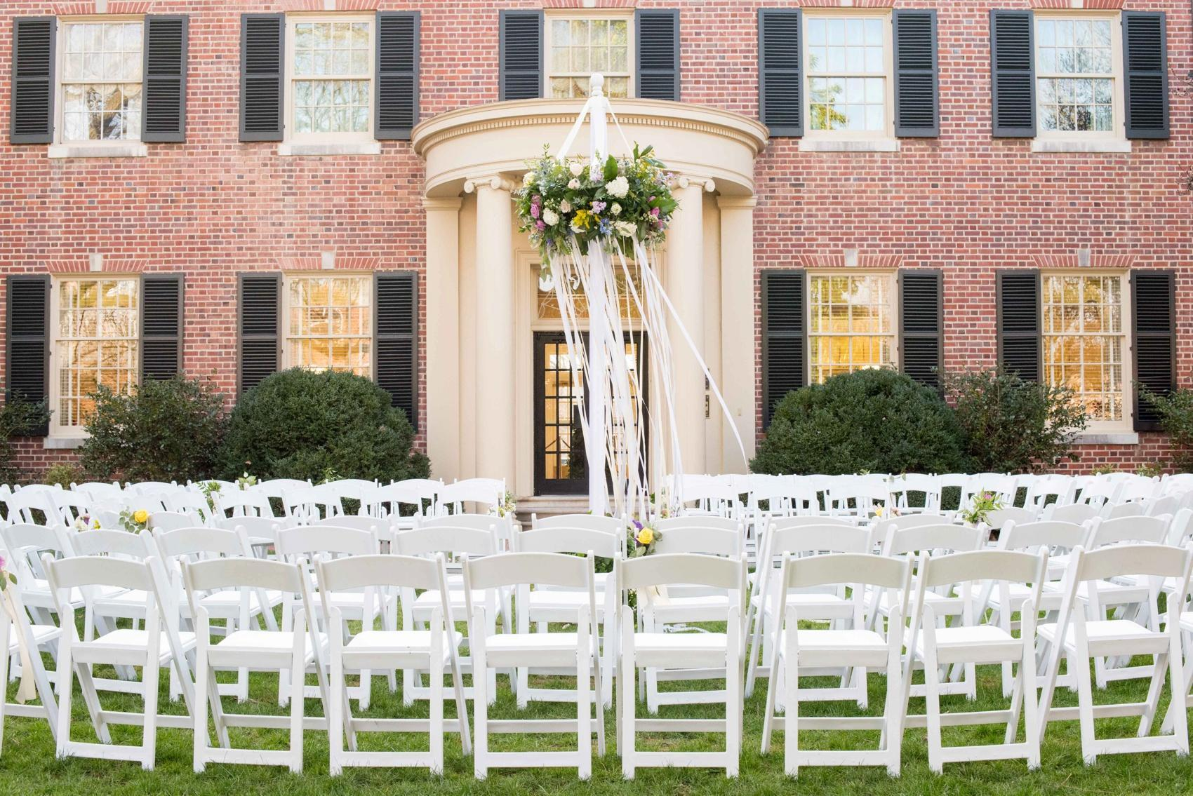 Ceremony chairs set up at The Carolina Inn in North Carolina, photographed by Mikkel Paige Photography.