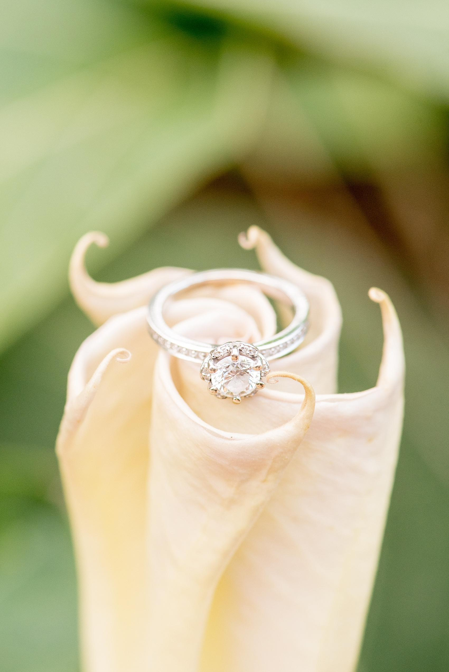 Raleigh North Carolina wedding photographer, Mikkel Paige Photography, photographs a romantic engagement session ring detail for a unique diamond piece.